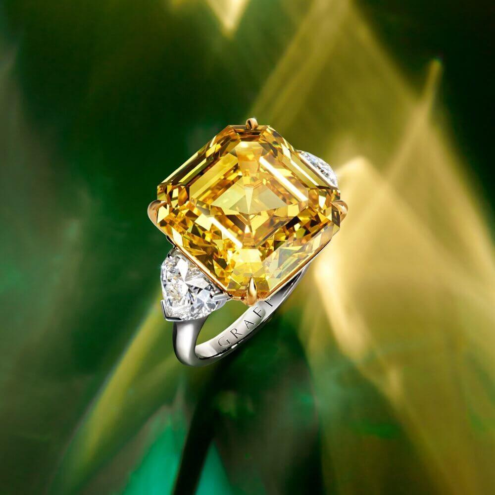 A Graff emerald cut yellow diamond ring
