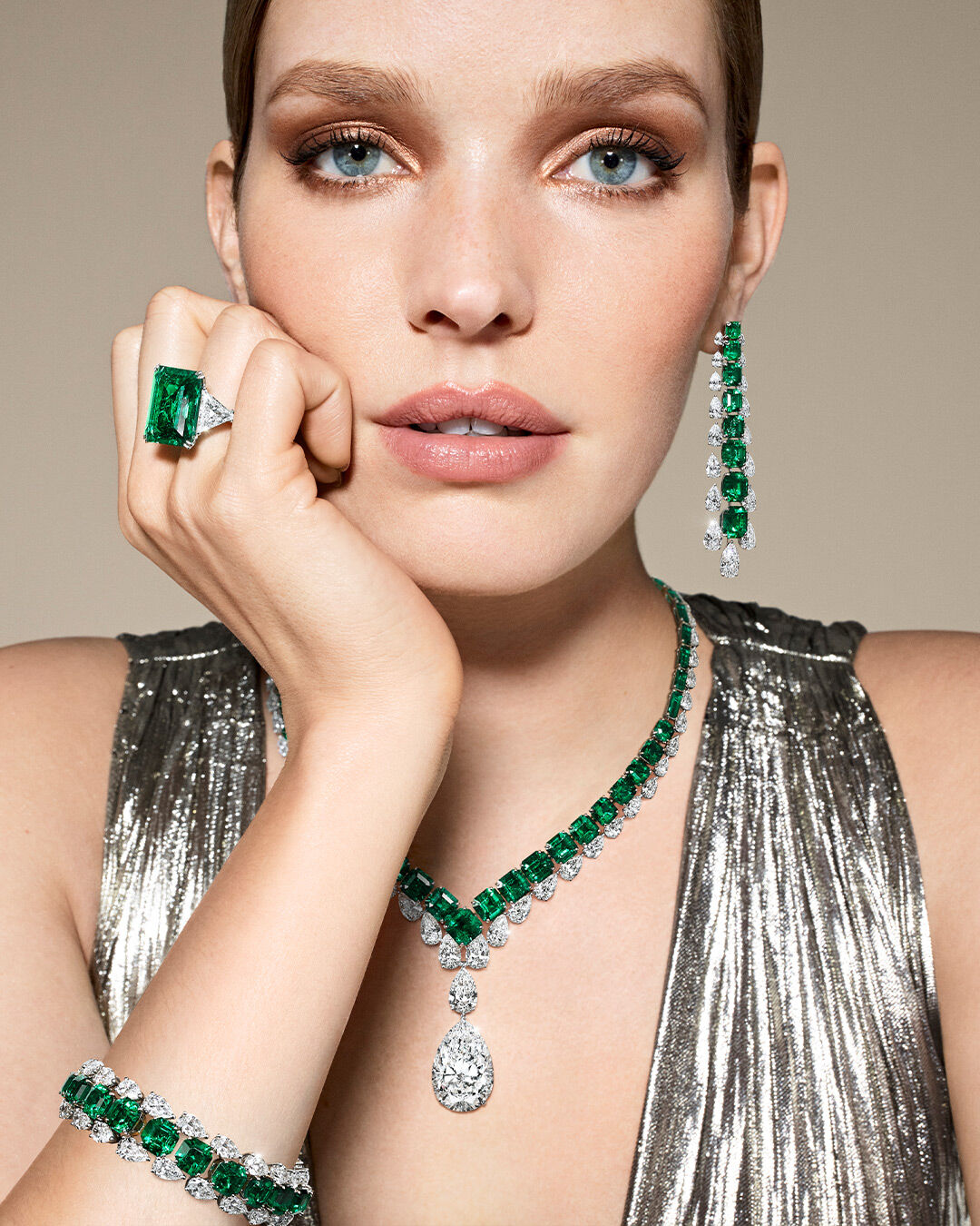 Model wears Graff emerald and white diamond high jewellery