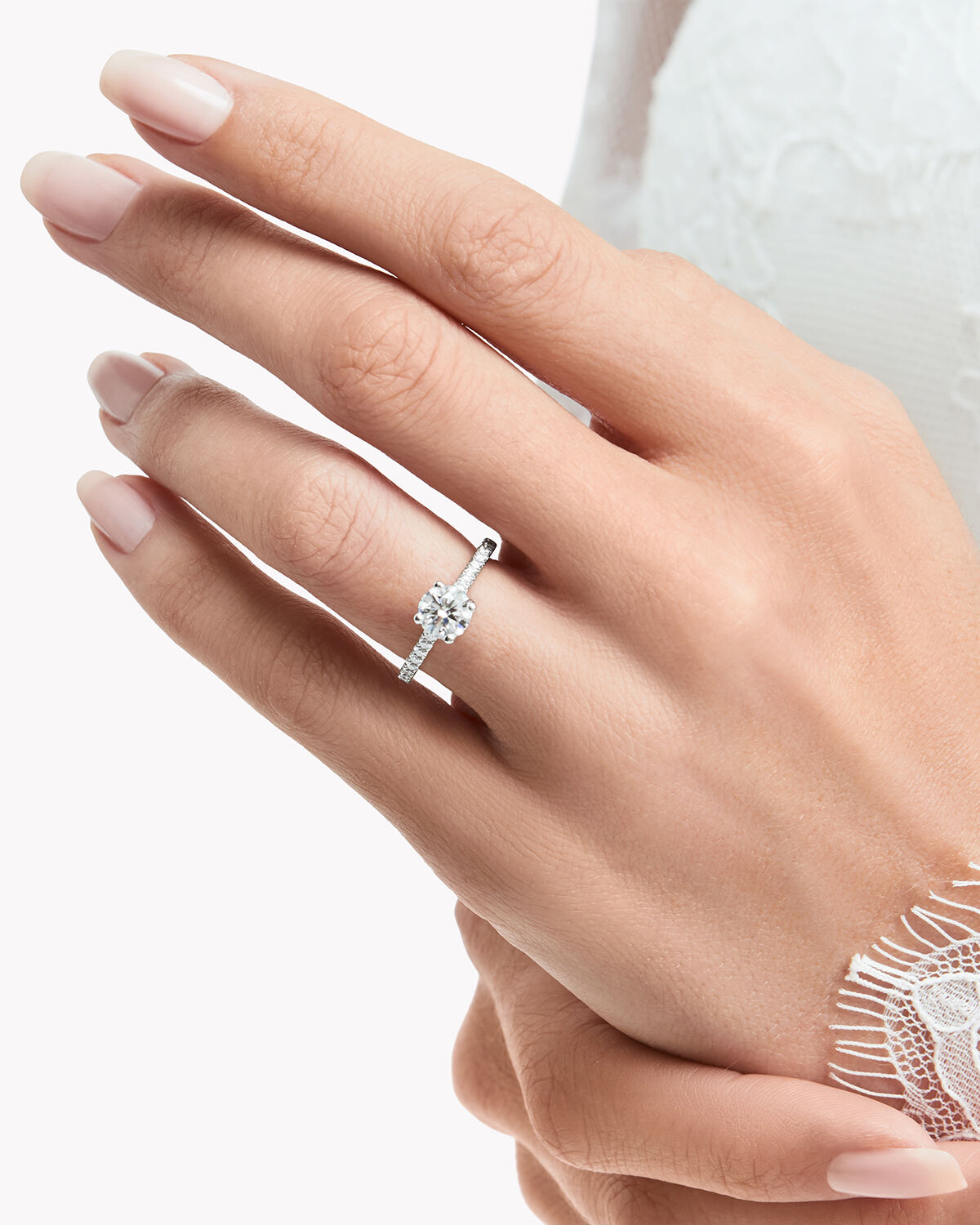 Close up of a model wearing a Graff Flame engagement ring