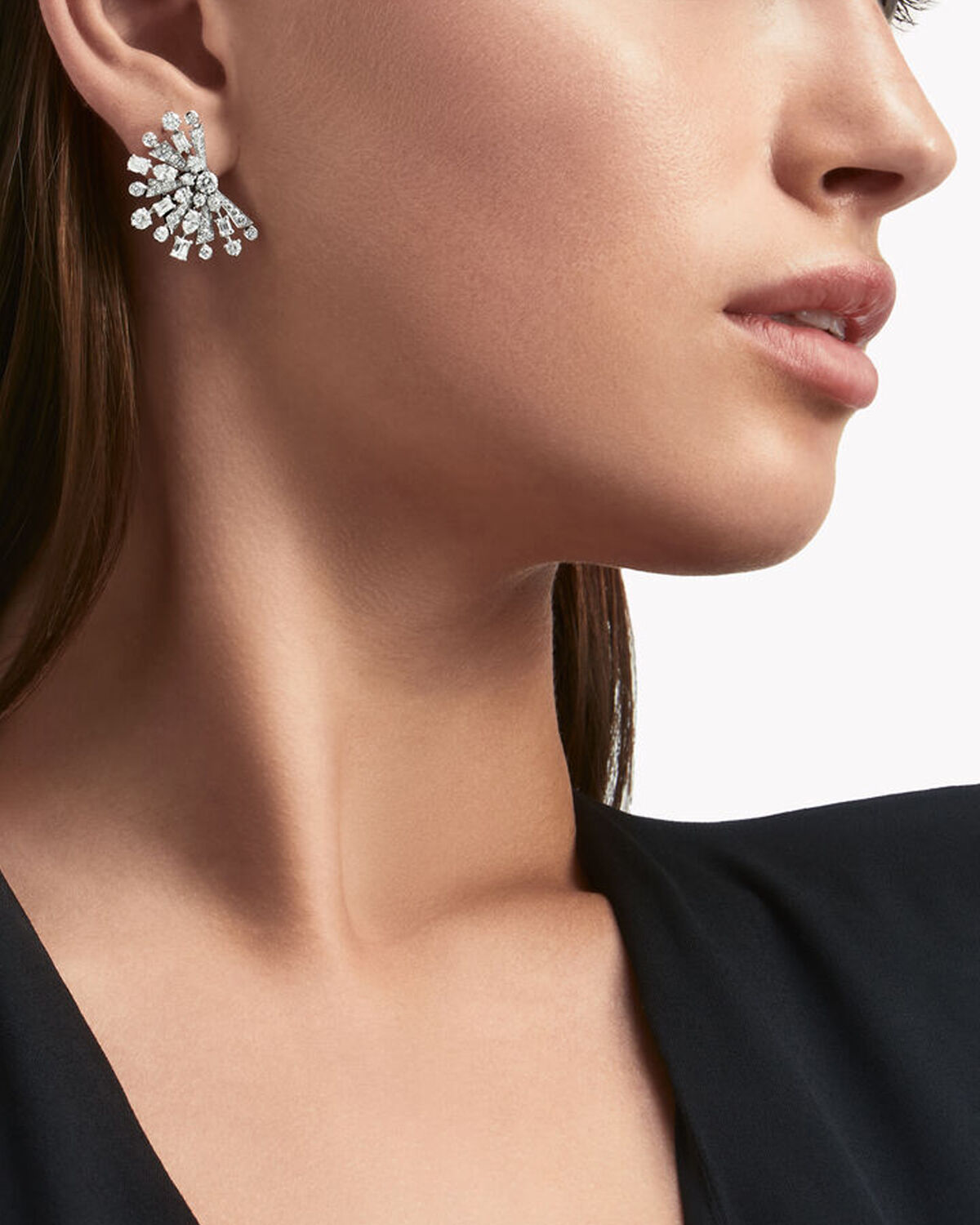 Close up of a model wears Graff Solar collection diamond jewellery
