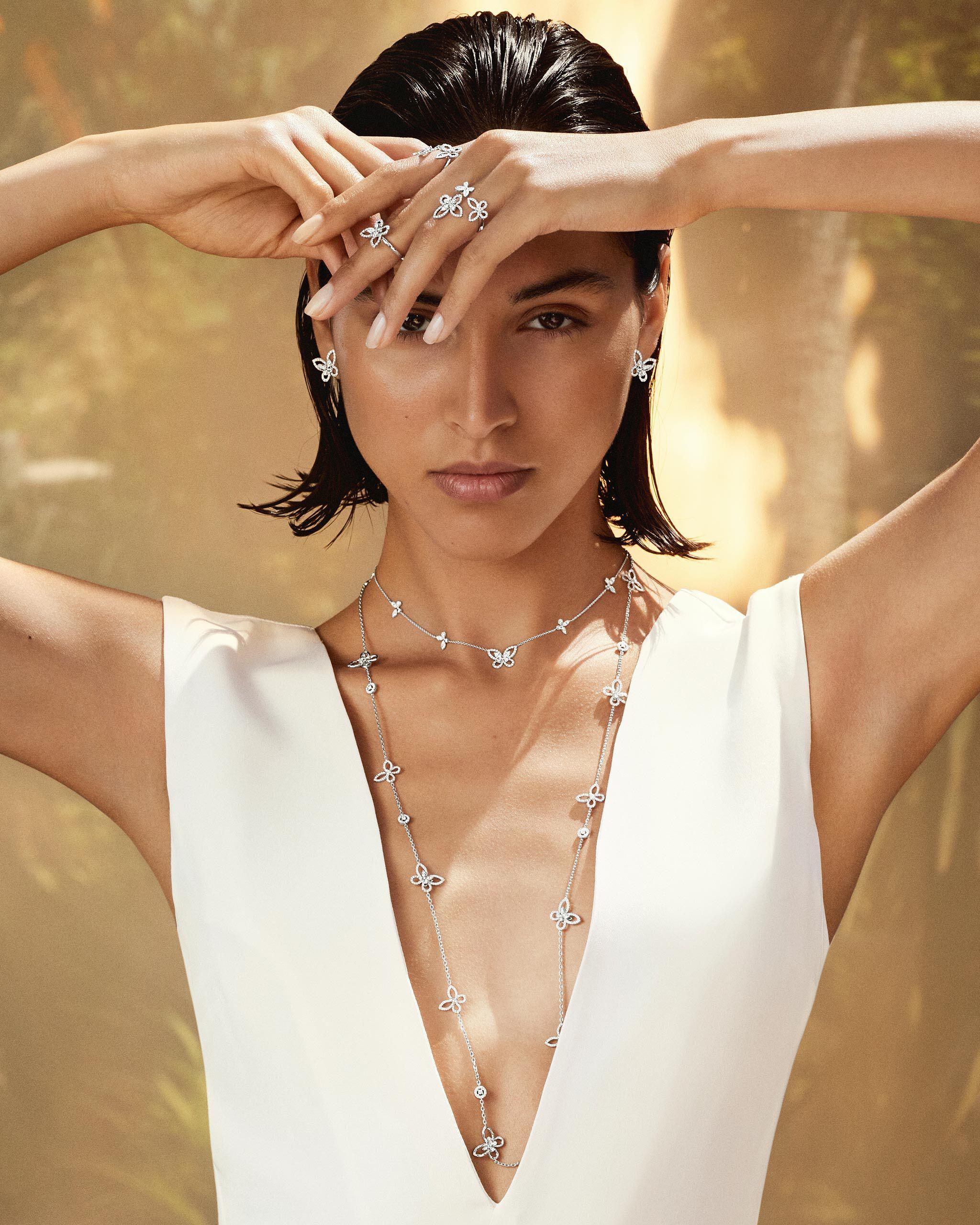 Model wears Graff Butterfly collection diamond jewellery in a pool