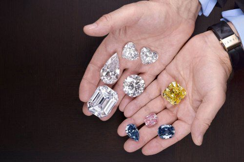 Close up of famous diamonds in the hands of Mr Laurence Graff