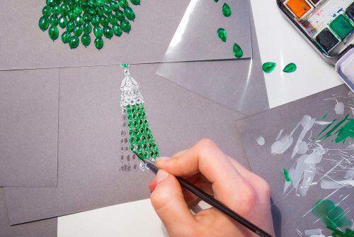 A Graff designer handplanting a gouache of an emerald and diamond necklace