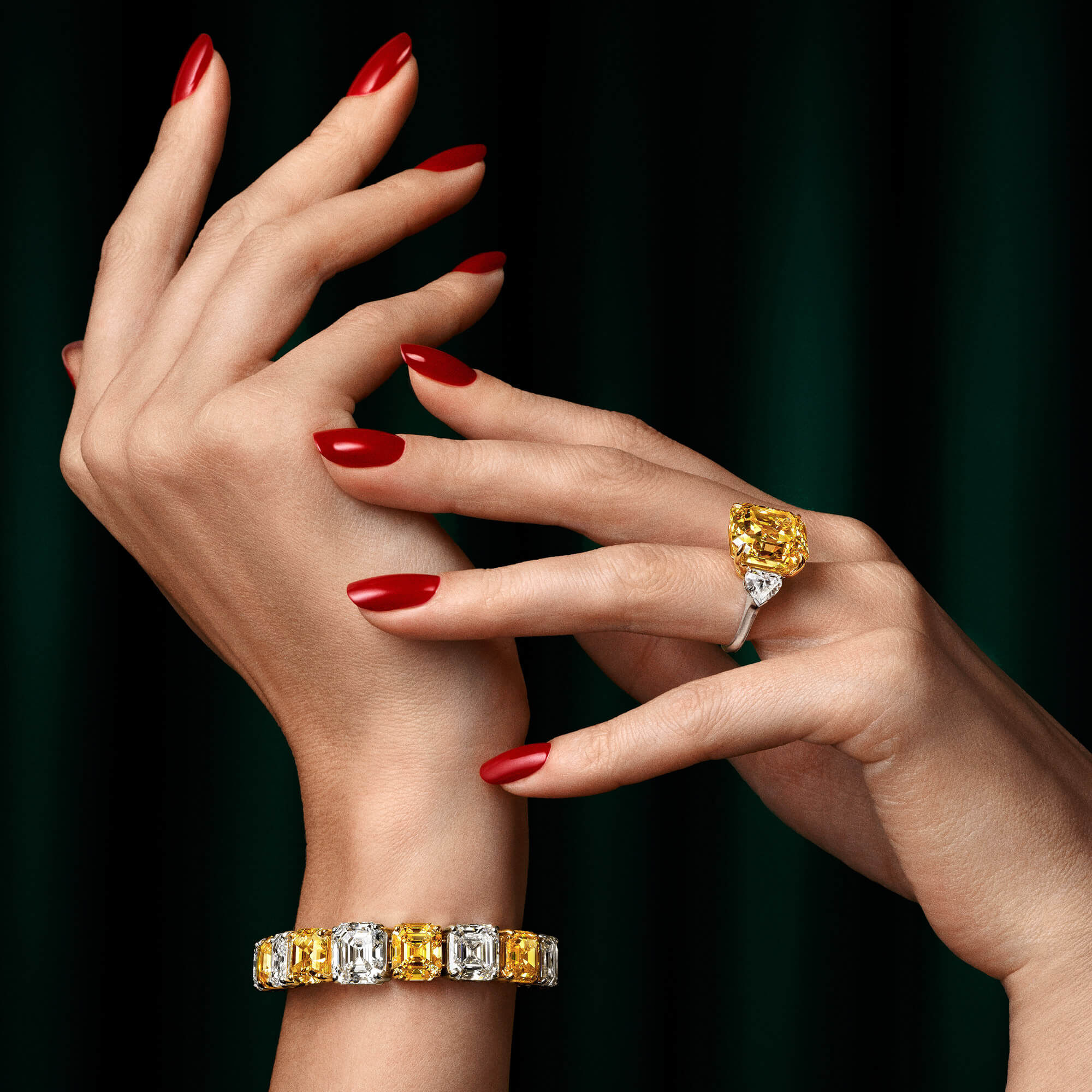 Model with yellow and white diamonds bracelet and yellow diamond ring