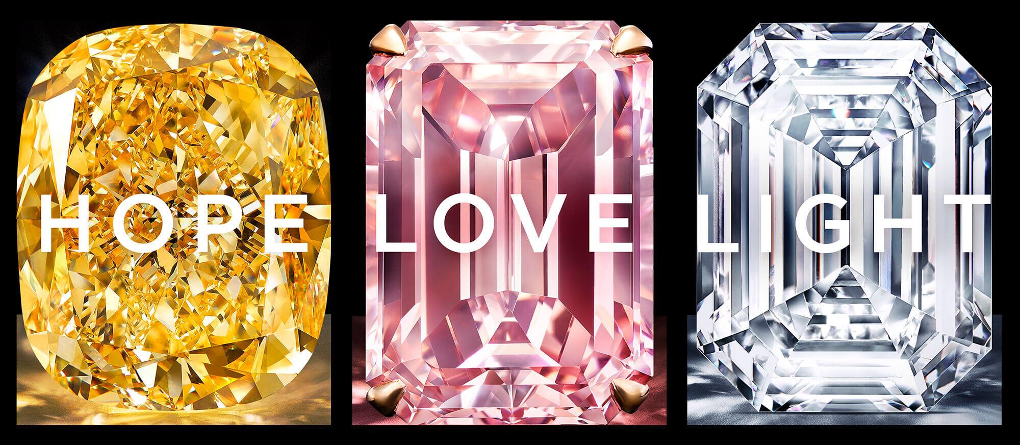 Three diamonds with with writing. Yellow diamond with Hope, Pink diamond with Love and White diamond with Light