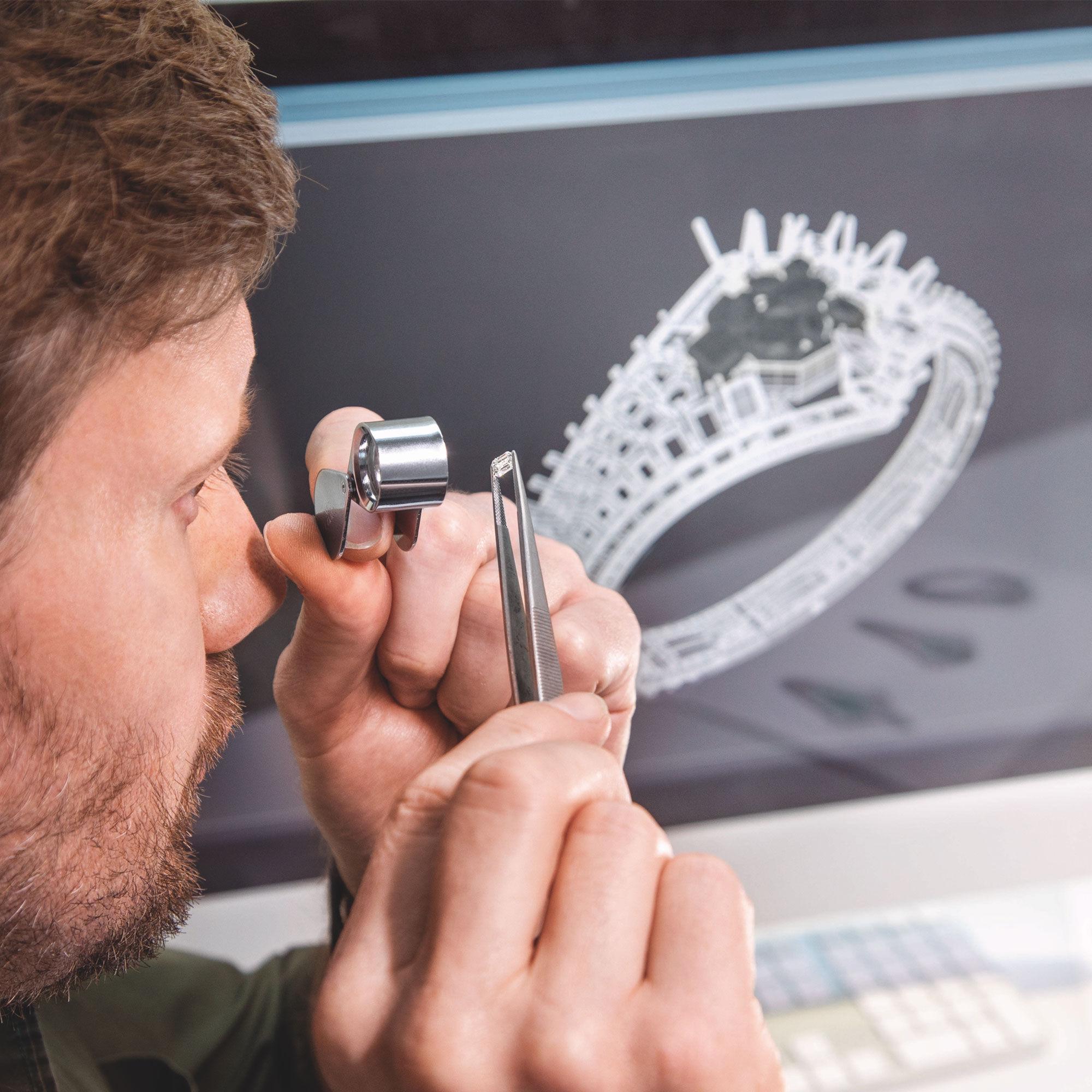 Graff Diamond setter examining a diamond