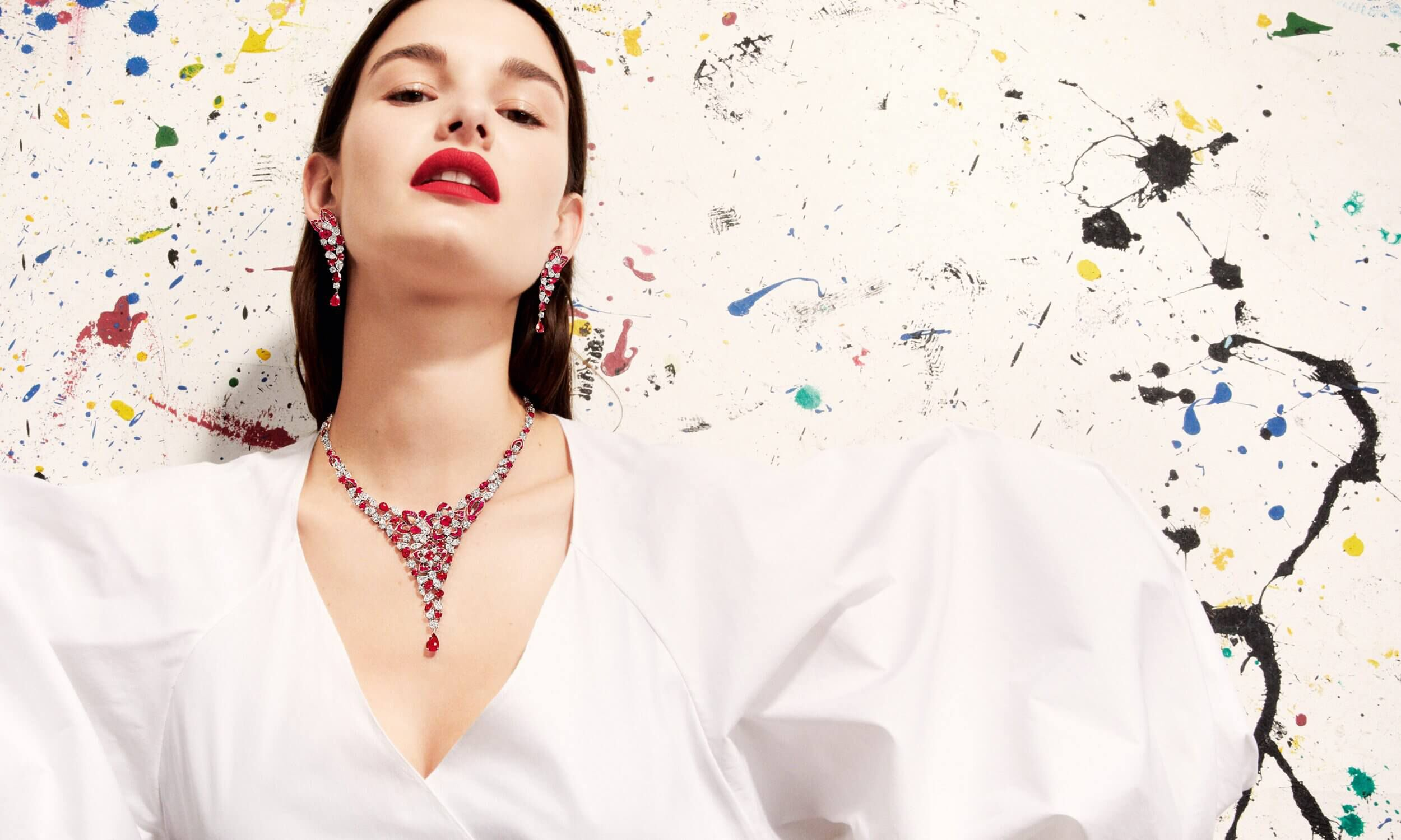 Graff Ruby and Diamond Peony Design necklace by Graff and Ruby and Diamond Peony earrings worn by a model
