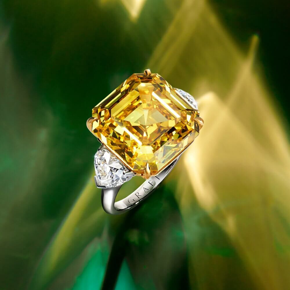 A Graff emerald cut yellow diamond ring