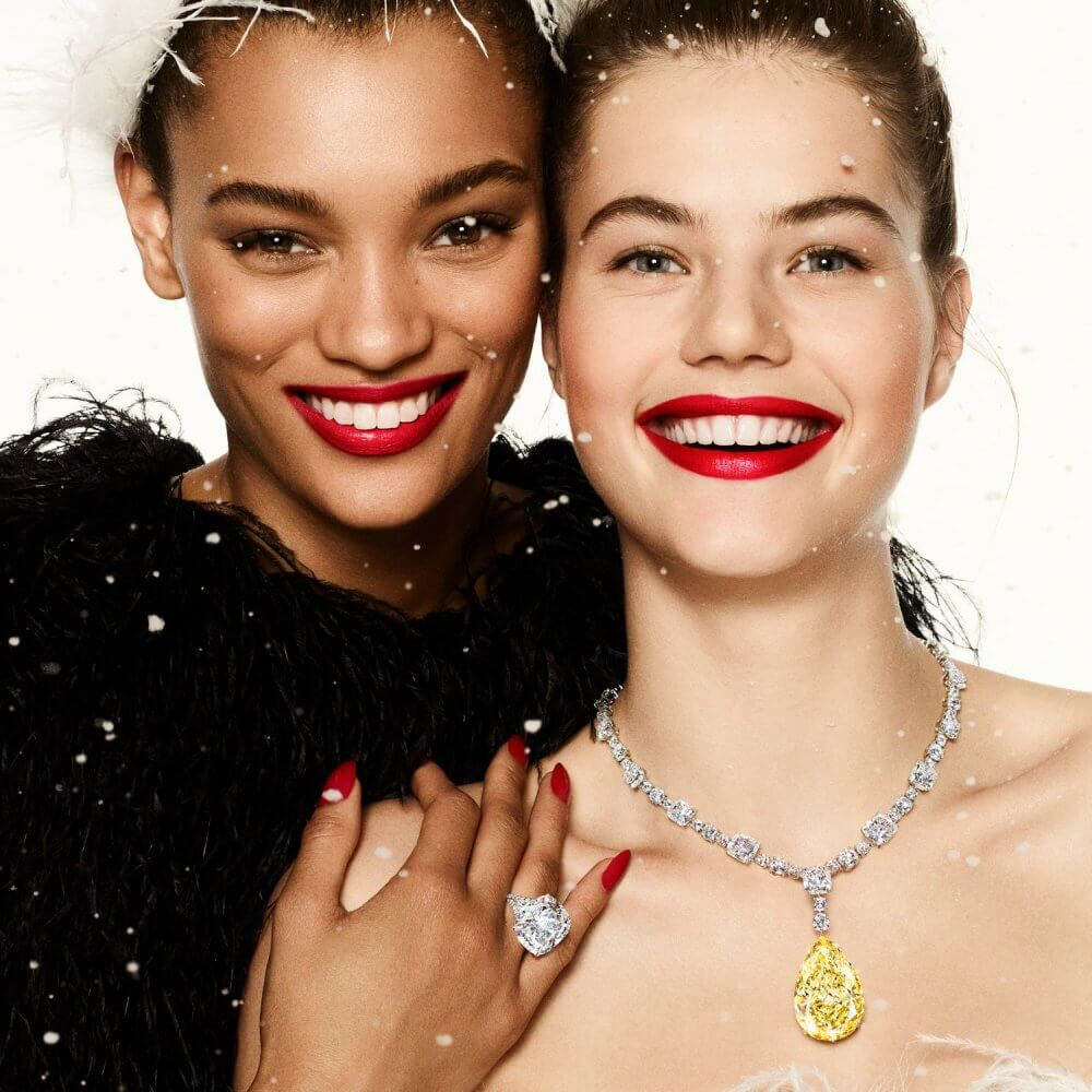 Two models wearing Graff yellow and white diamond high jewellery