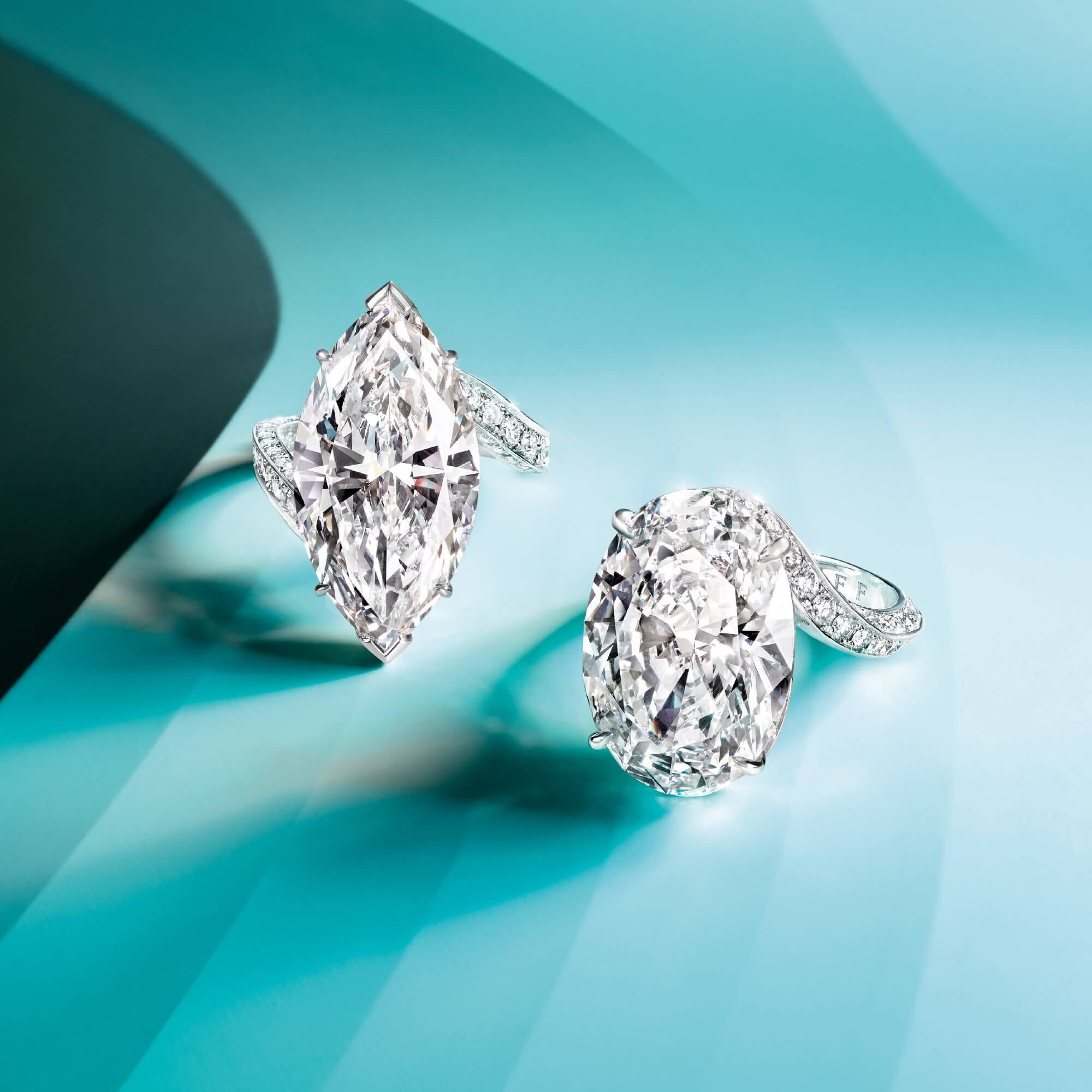 Two Graff diamond rings featuring a marquise shape diamond and an oval shape diamond respectively