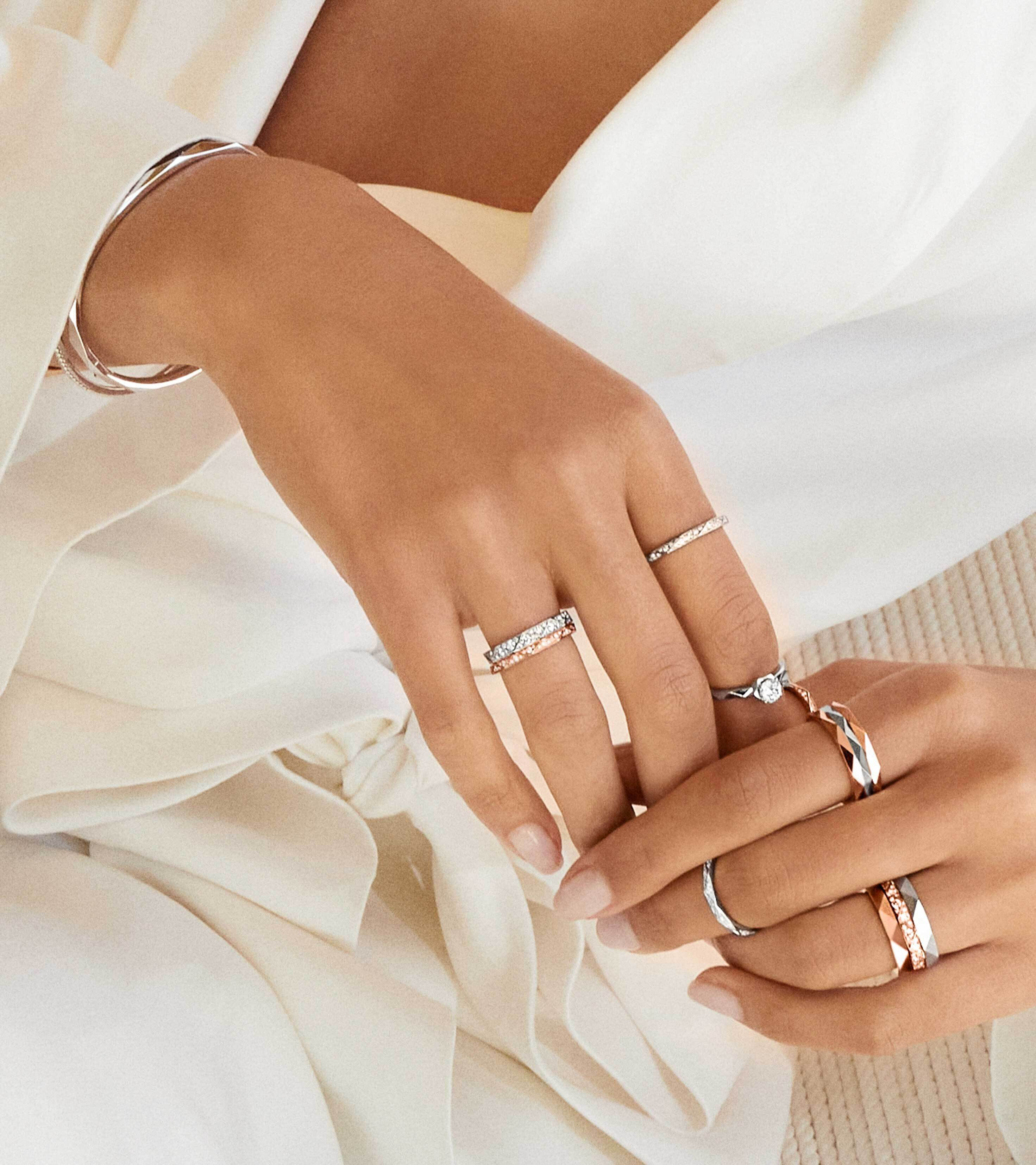 Close up of a model's hand wearing Laurence Graff Signature jewellery collection rings