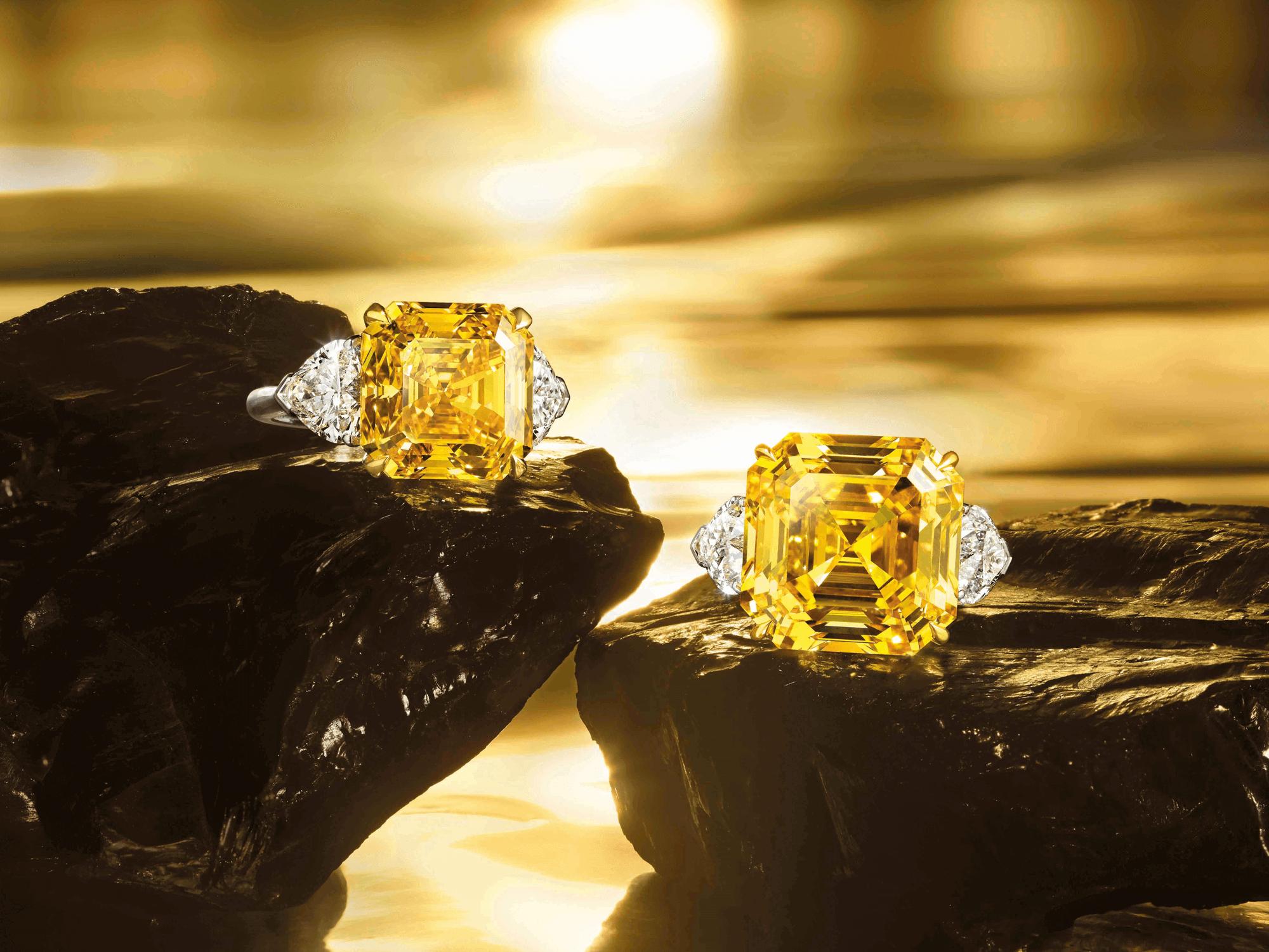 Two Graff Emerald Cut Yellow Diamond Ring set with white diamond shoulder stones