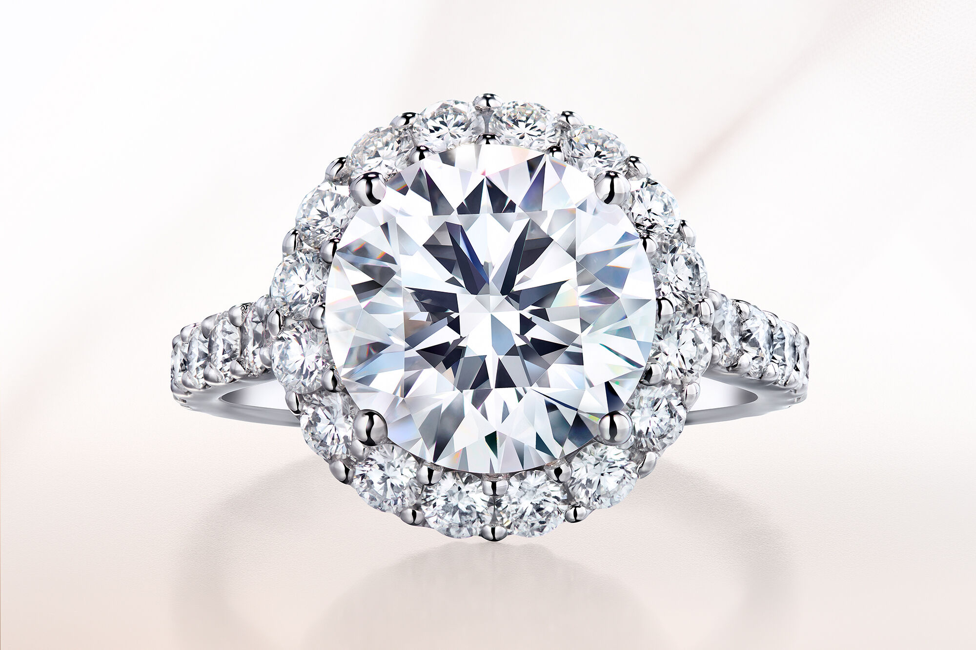 Close up of a round diamond Icon setting engagement ring by Graff