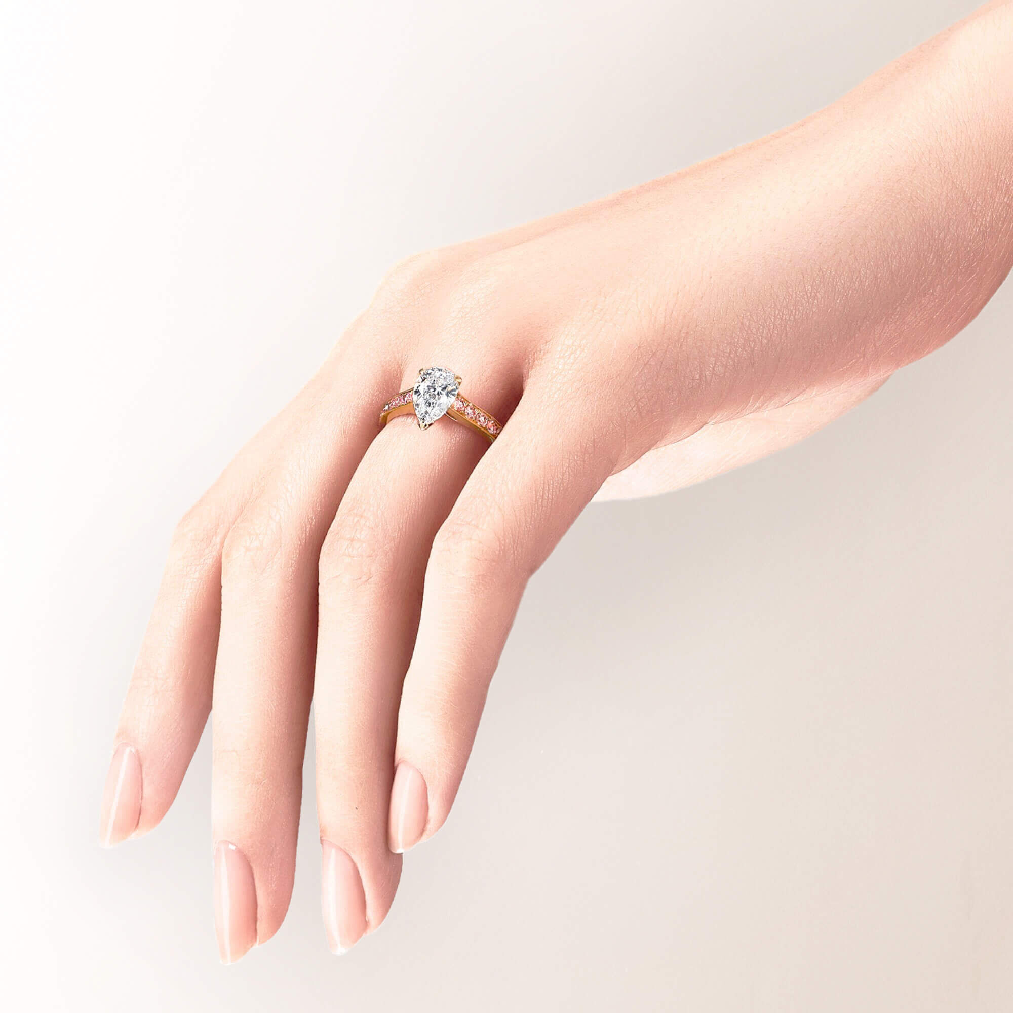 A models hand wearing a Graff pear shape diamond engagement ring