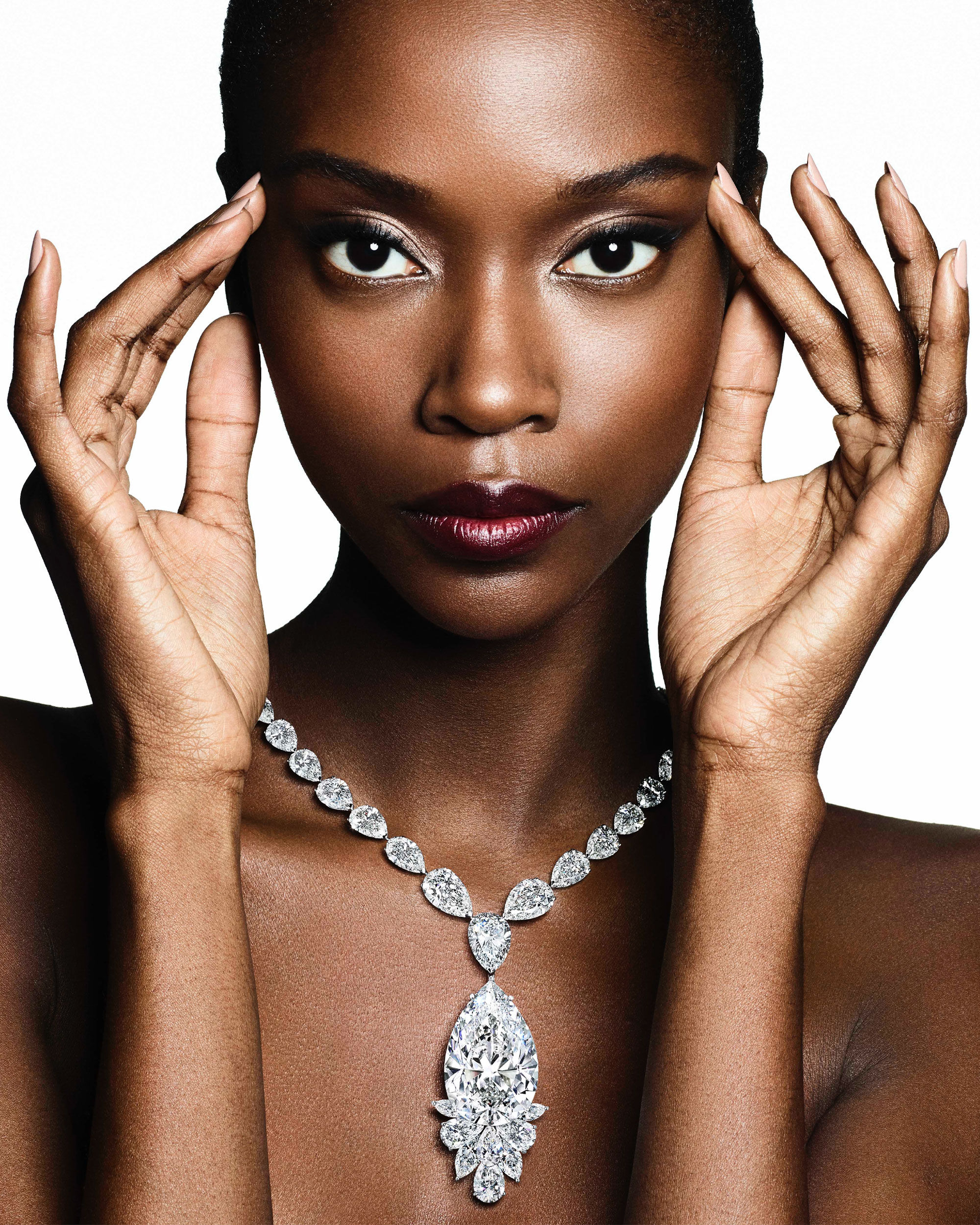 Model wears a Graff high jewellery diamond necklace featuring a pear shape diamond from the Meya Prosperity