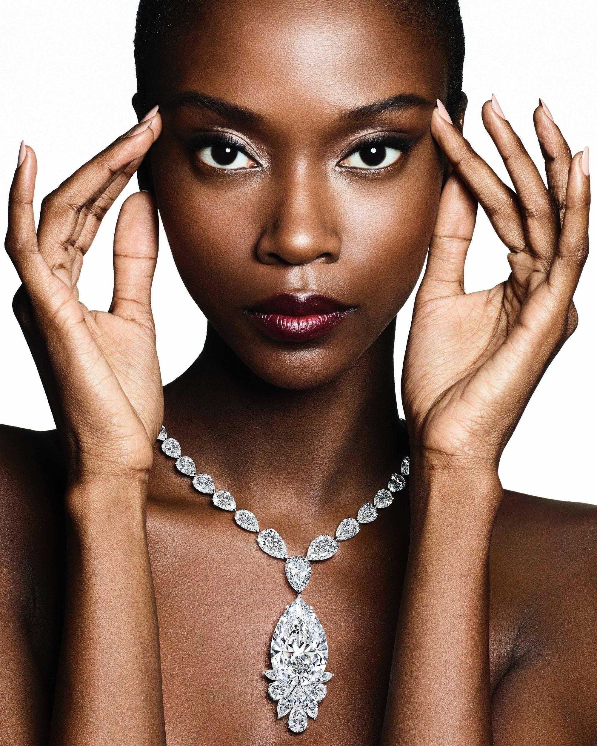 Model wears a Graff high jewellery diamond necklace featuring a pear shape diamond from the Meya Prosperity