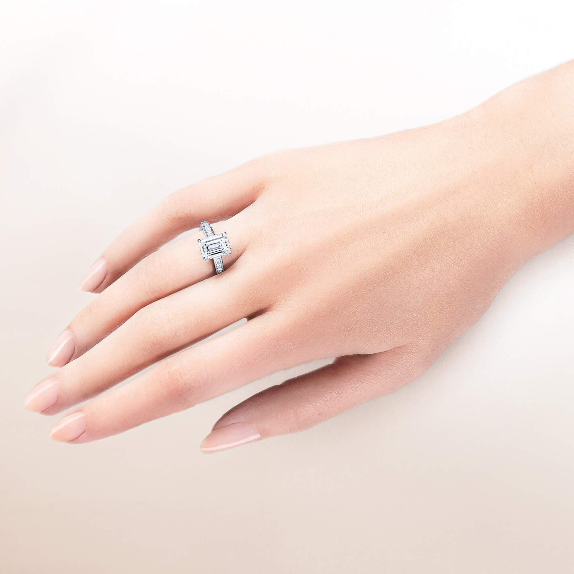 Close up of a models hand wearing a Graff heart shape diamond engagement ring