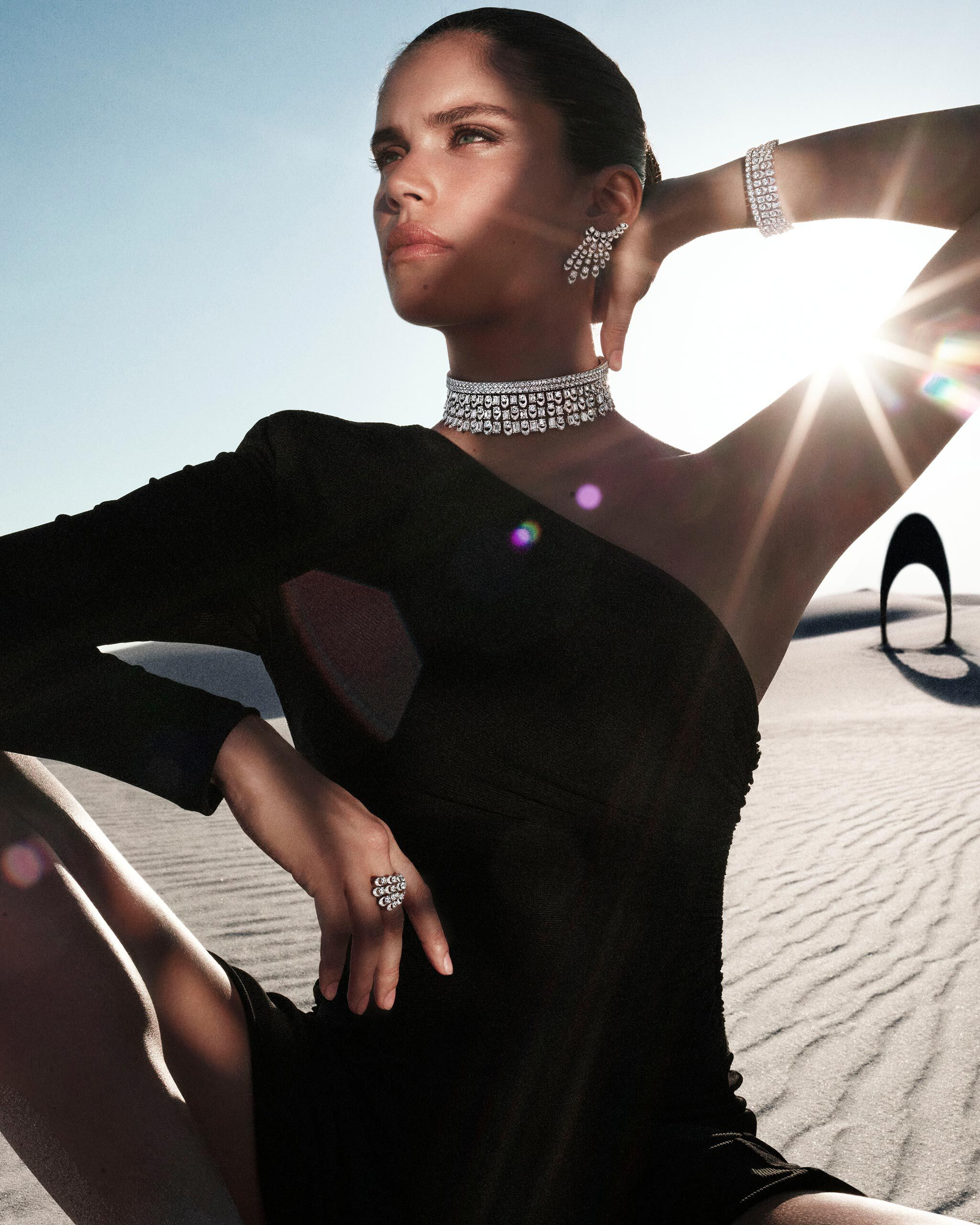 Model wears Graff Gateway diamond jewels from the Tribal collection in  a dessert.