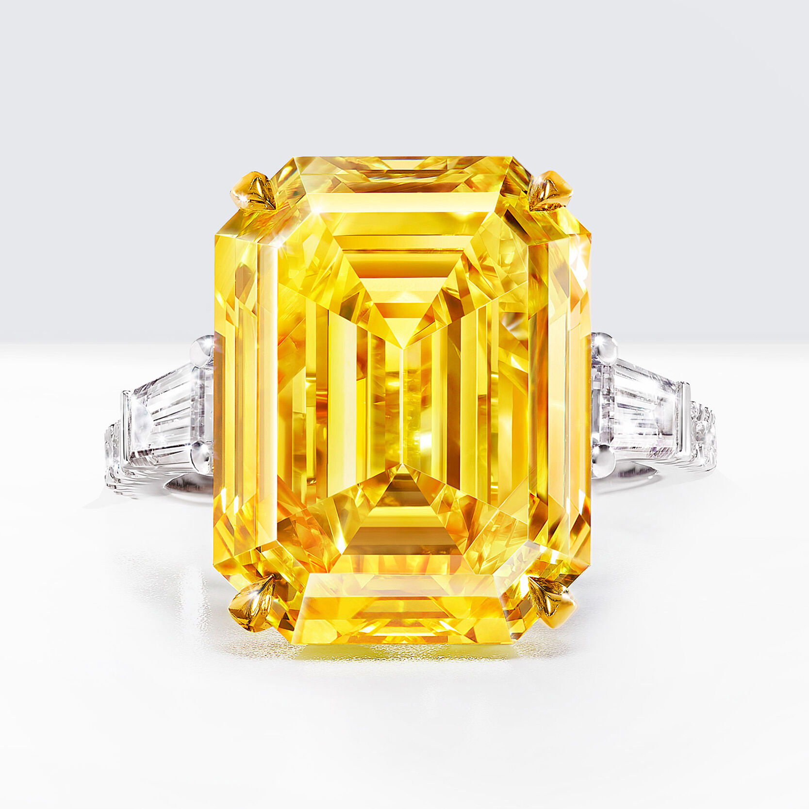 An emerald cut yellow and white diamond ring by Graff