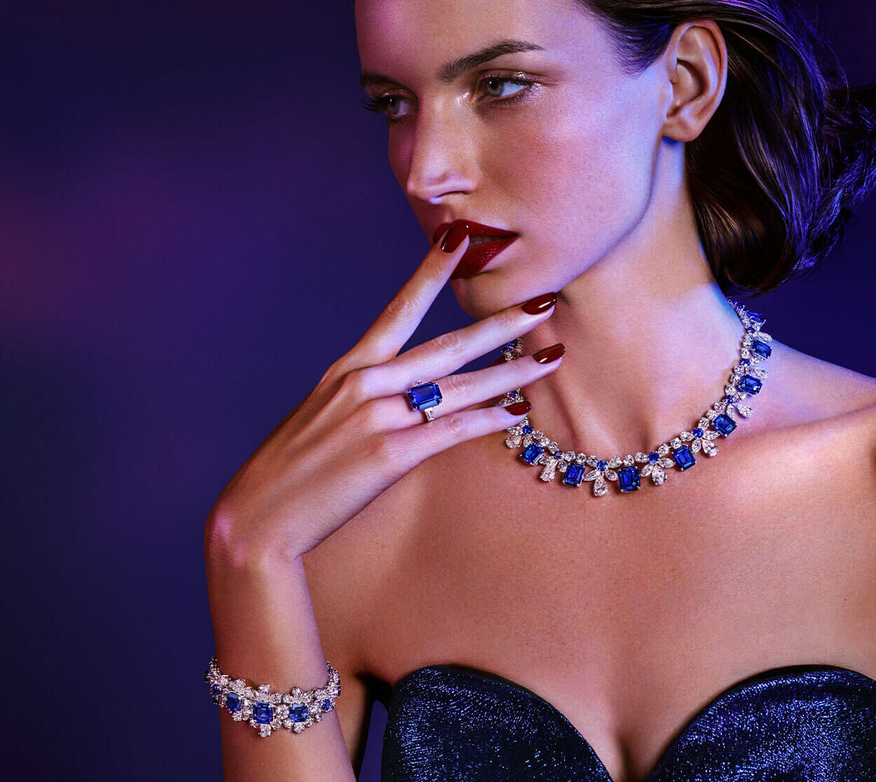 Graff high jewellery Royal Blue sapphire and diamond bracelet, Royal Blue sapphire ring and sapphire and diamond necklace and a close up image of the bracelet