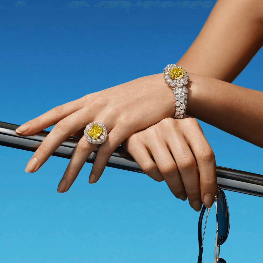 a lady on a boat wearing graff yellow diamond ring and bracelet