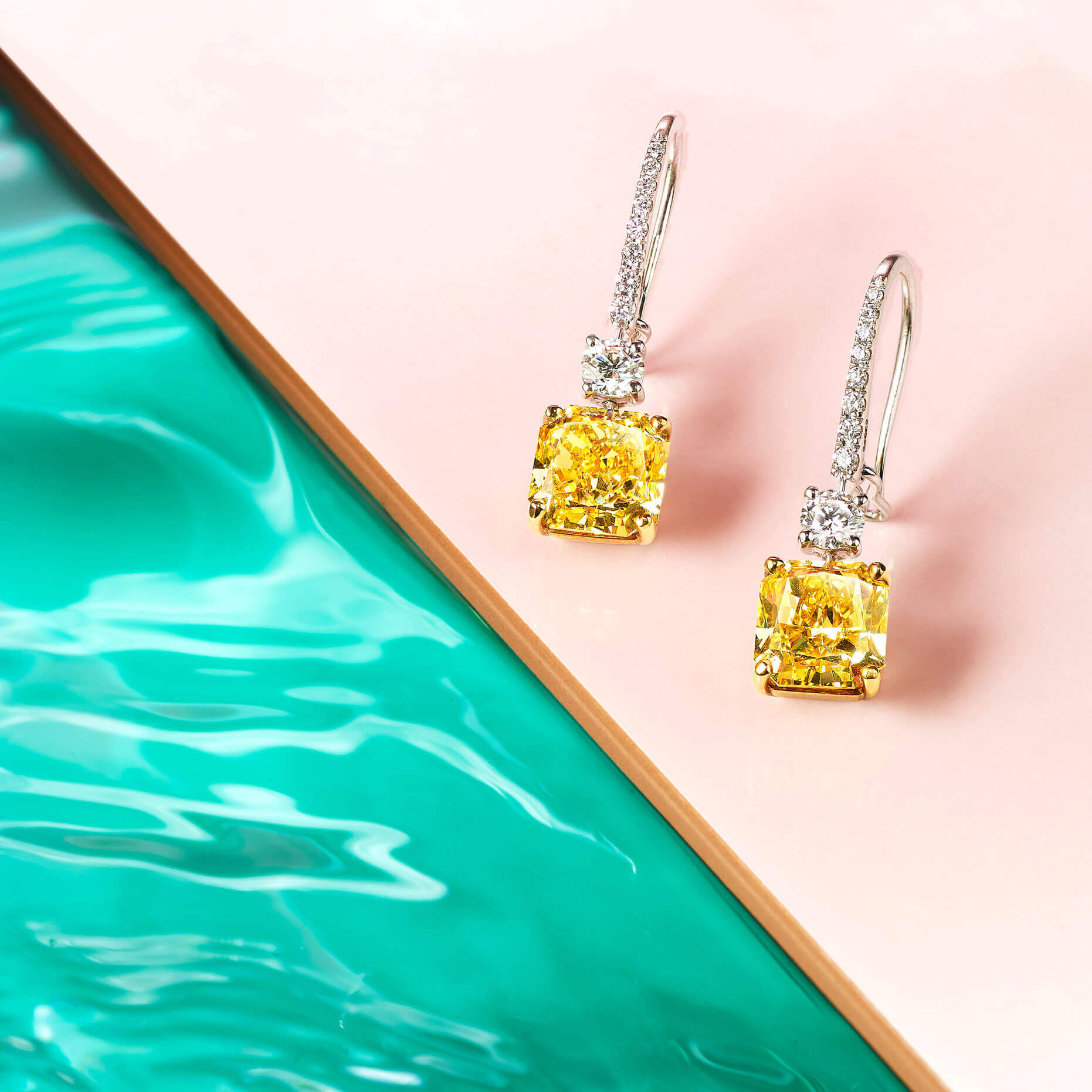 Graff Classic Graff collection Yellow and white diamond earrings at a pool side