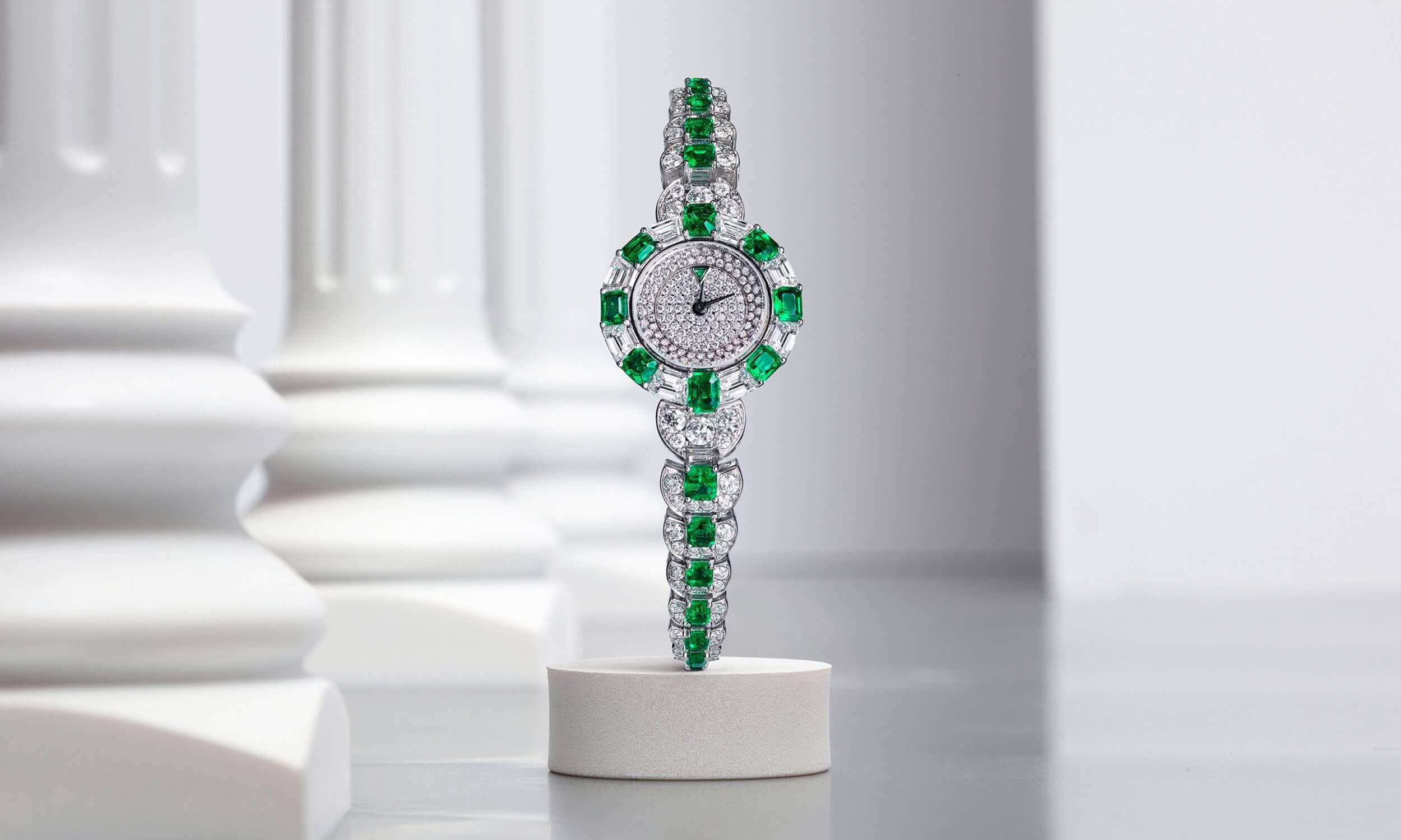 Graff Mini Deco Watch Emerald and Diamond on a Multishape Emerald and Diamond Bracelet inside a Gallery