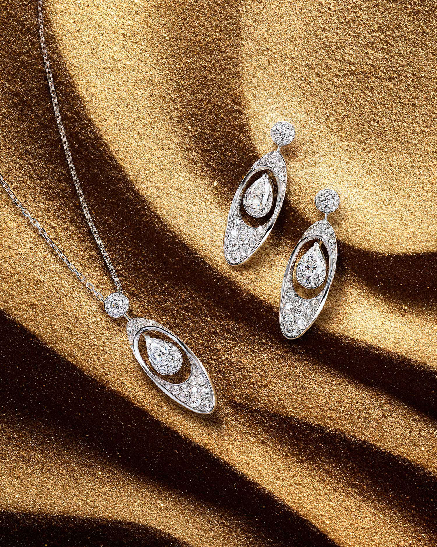 The abstract Graff Gateway motif is showcased in a pendant and earrings