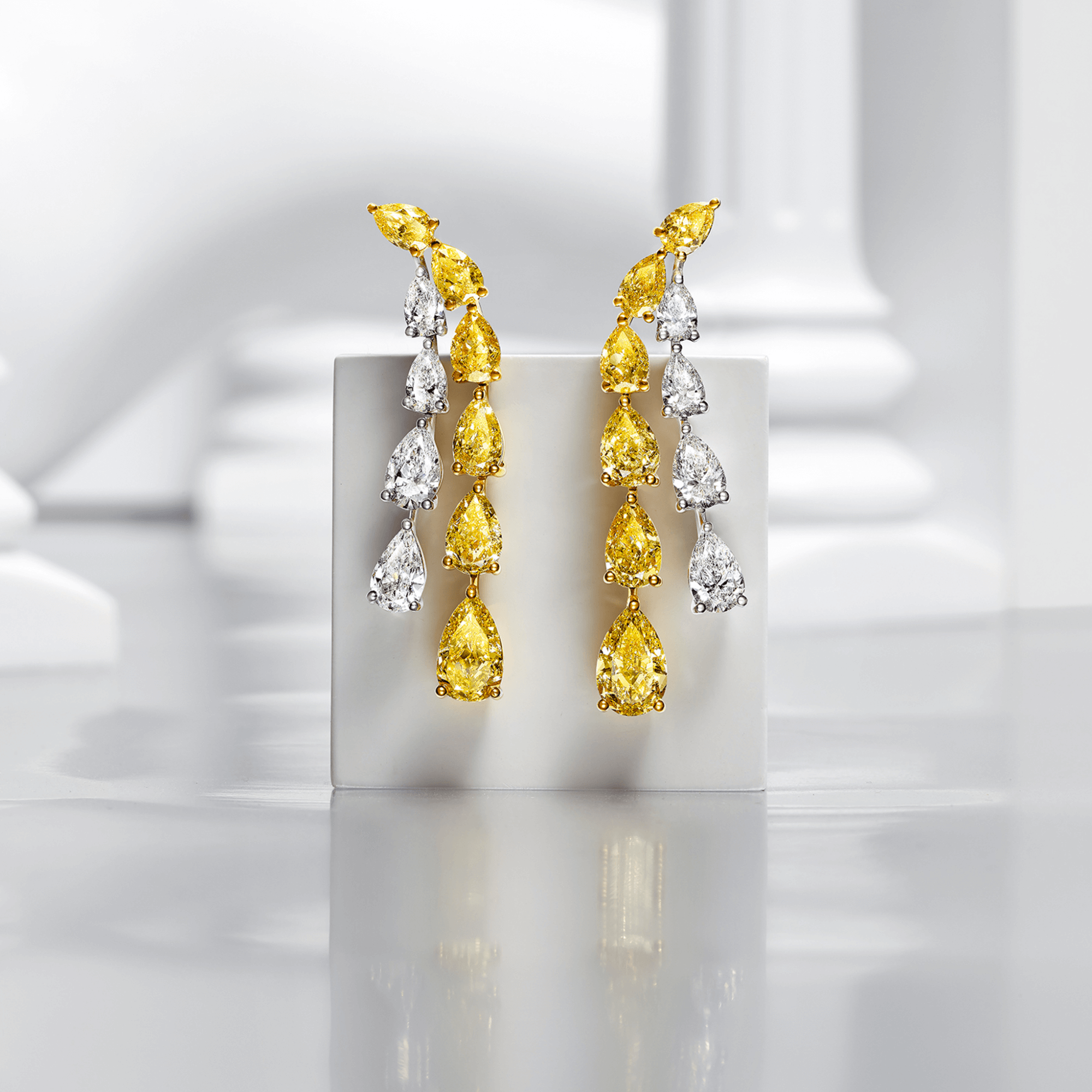 Graff Yellow And White Pear Shaped Diamond High Jewellery Earrings inside a Gallery