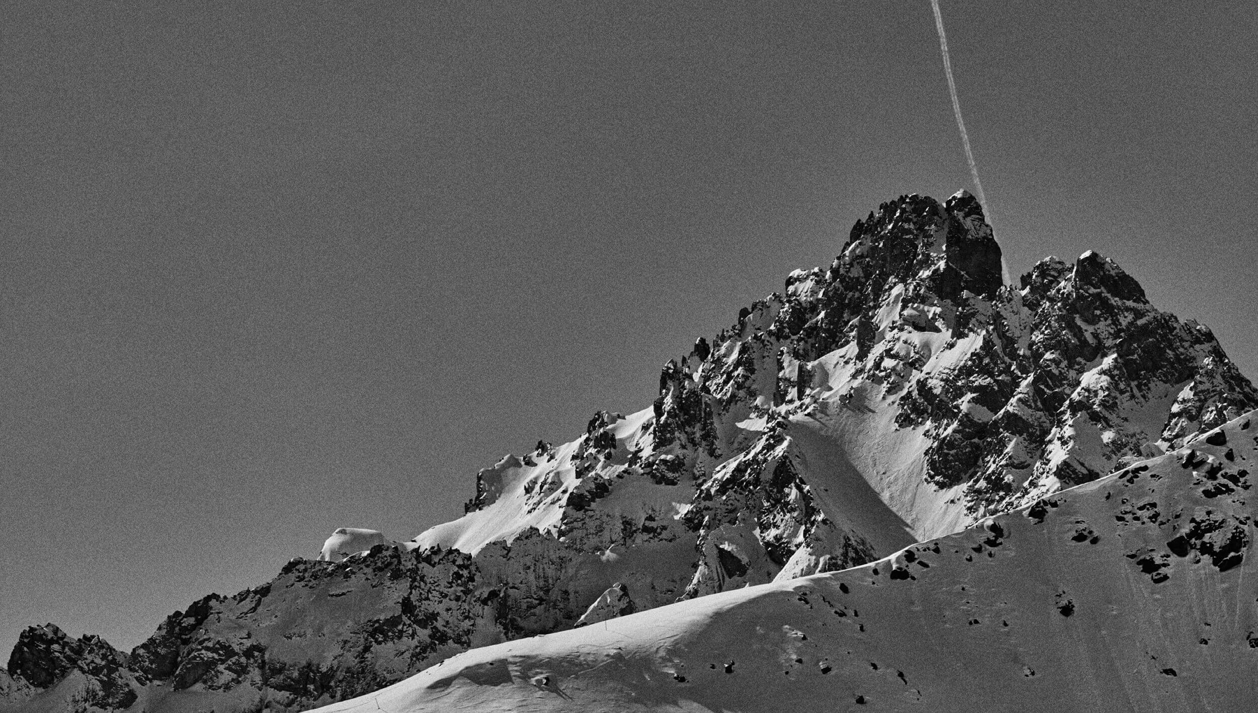 A photograph of an alpine mountain peak