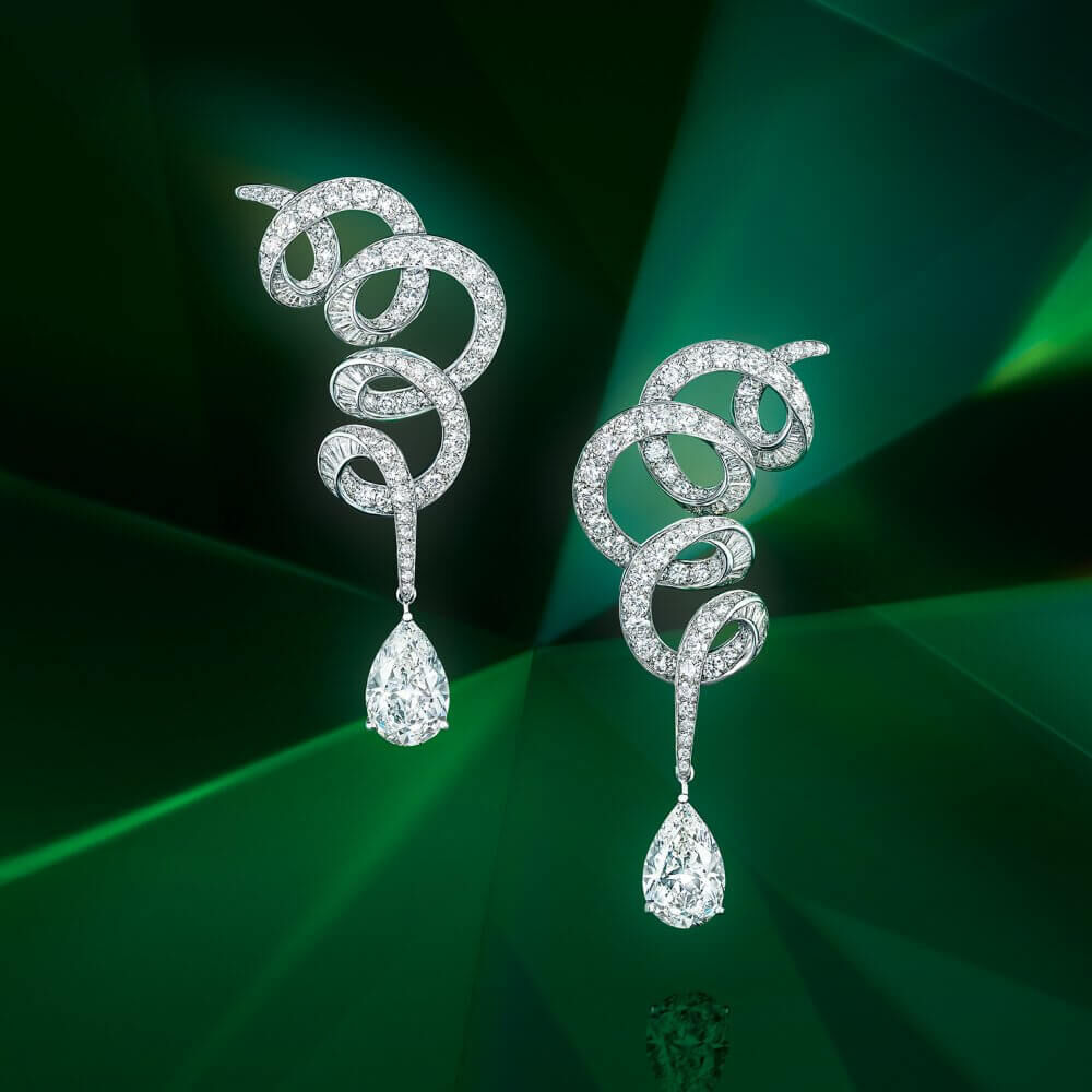 A pair of Graff earrings inspired by Twombly on green background
