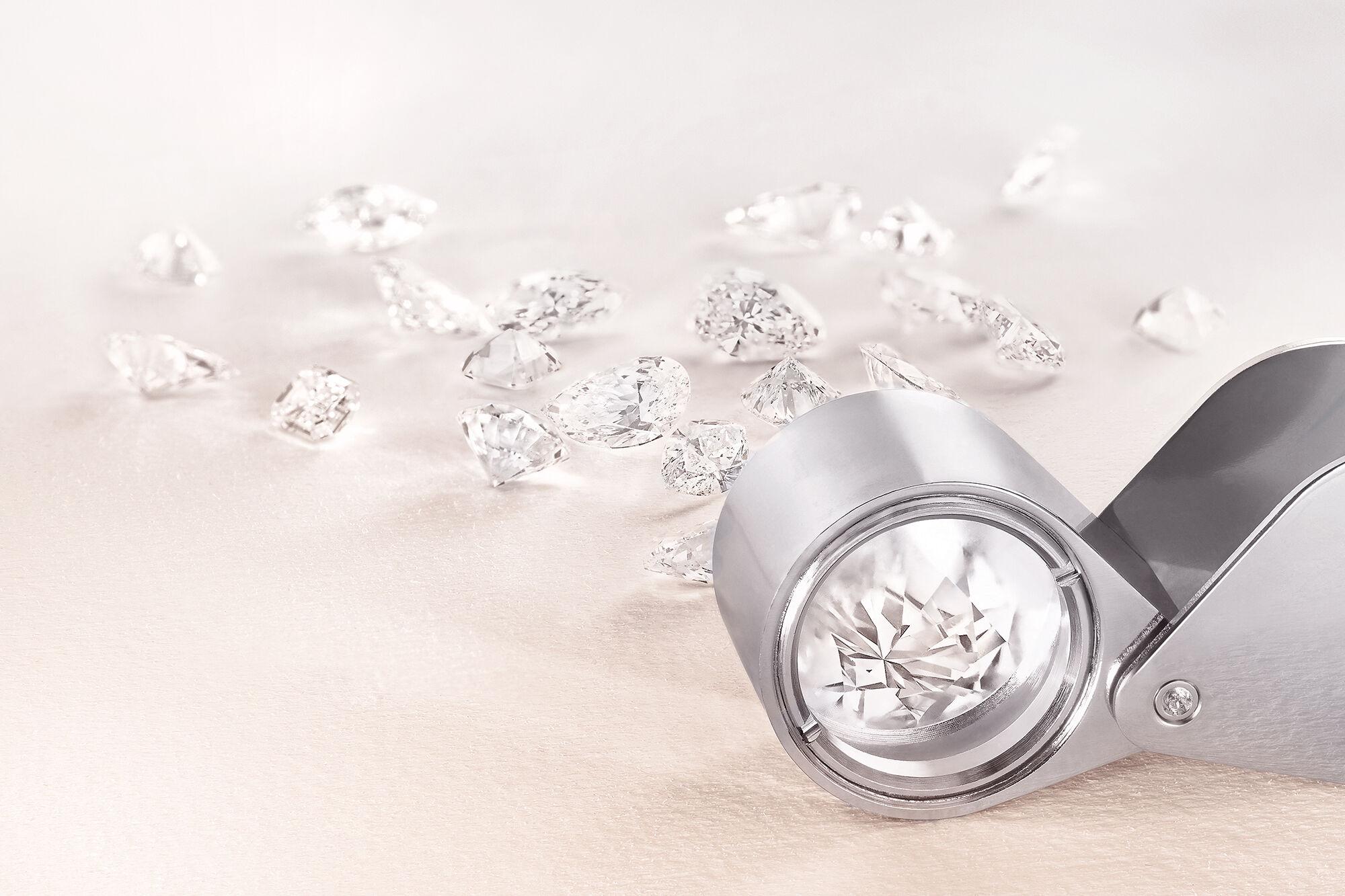 Close up of Graff diamonds and a loupe