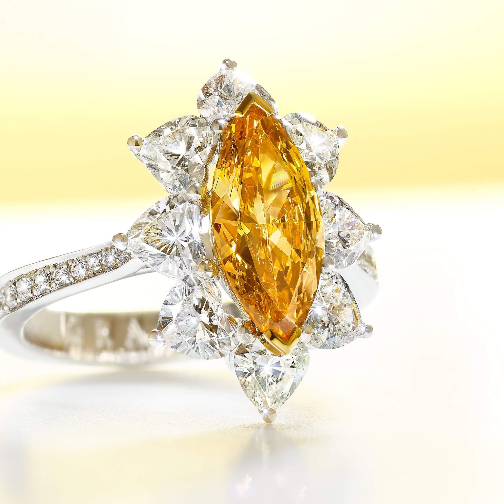 A 1 carat Fancy Vivid Yellow Orange marquise diamond Graff ring