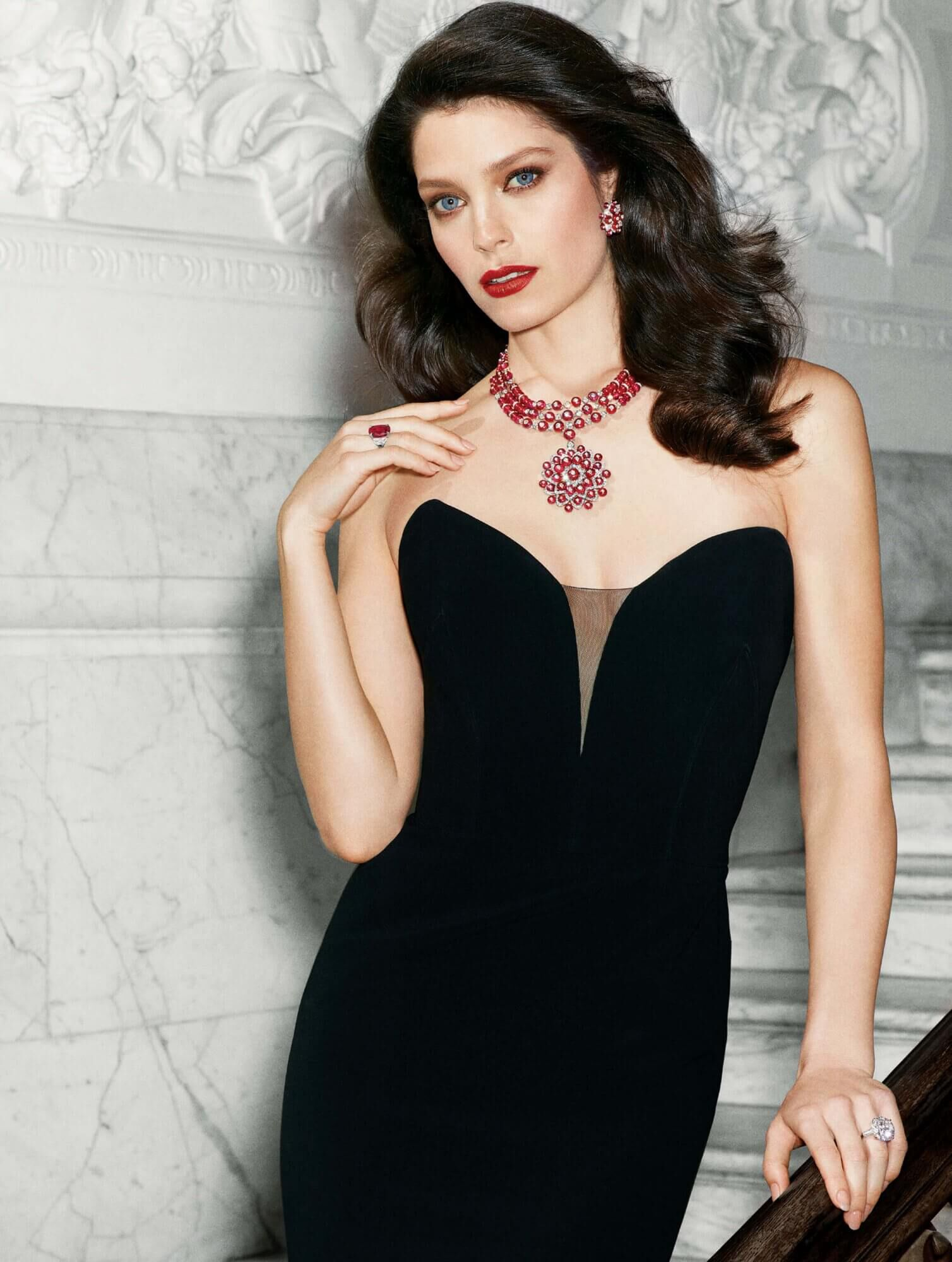 Model wears Graff Diamonds Beaded ruby and diamond earrings and necklace with cushion cut ruby and diamond ring