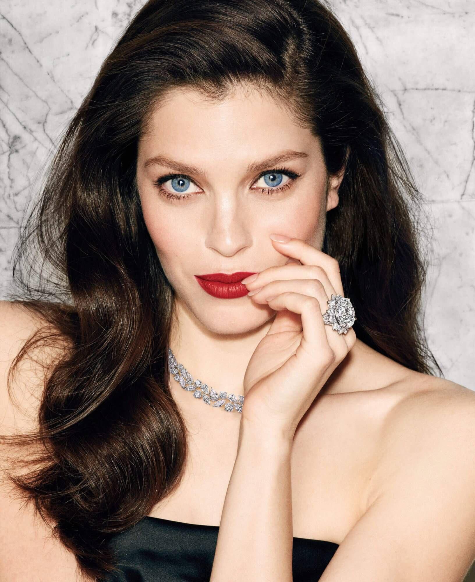 Model wears Graff Diamonds Lights Camera Action Article 30.88 carat D Flawless round diamond ring and Multishape diamond necklace
