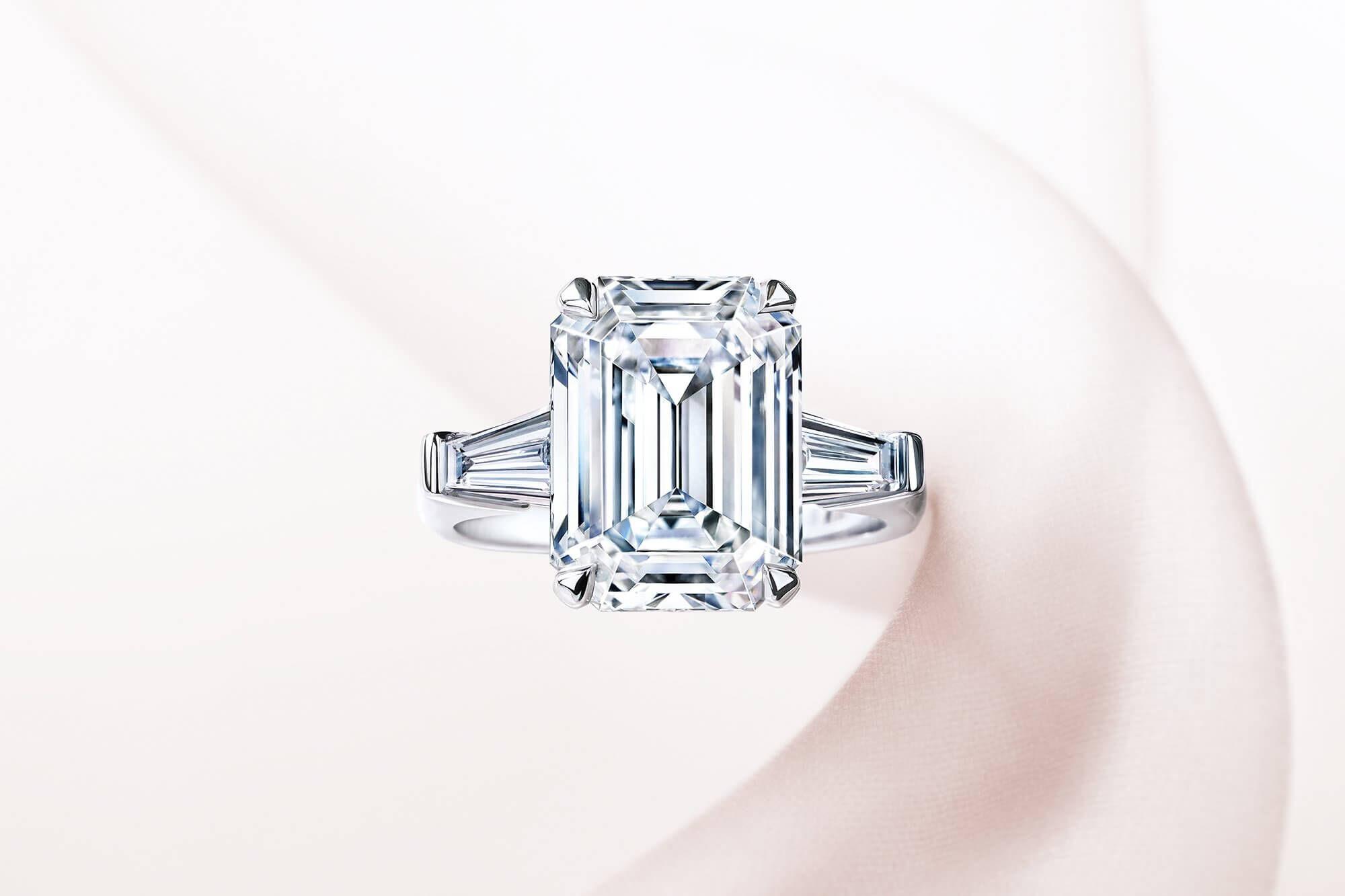 A Graff emerald cut diamond Promise setting engagement ring