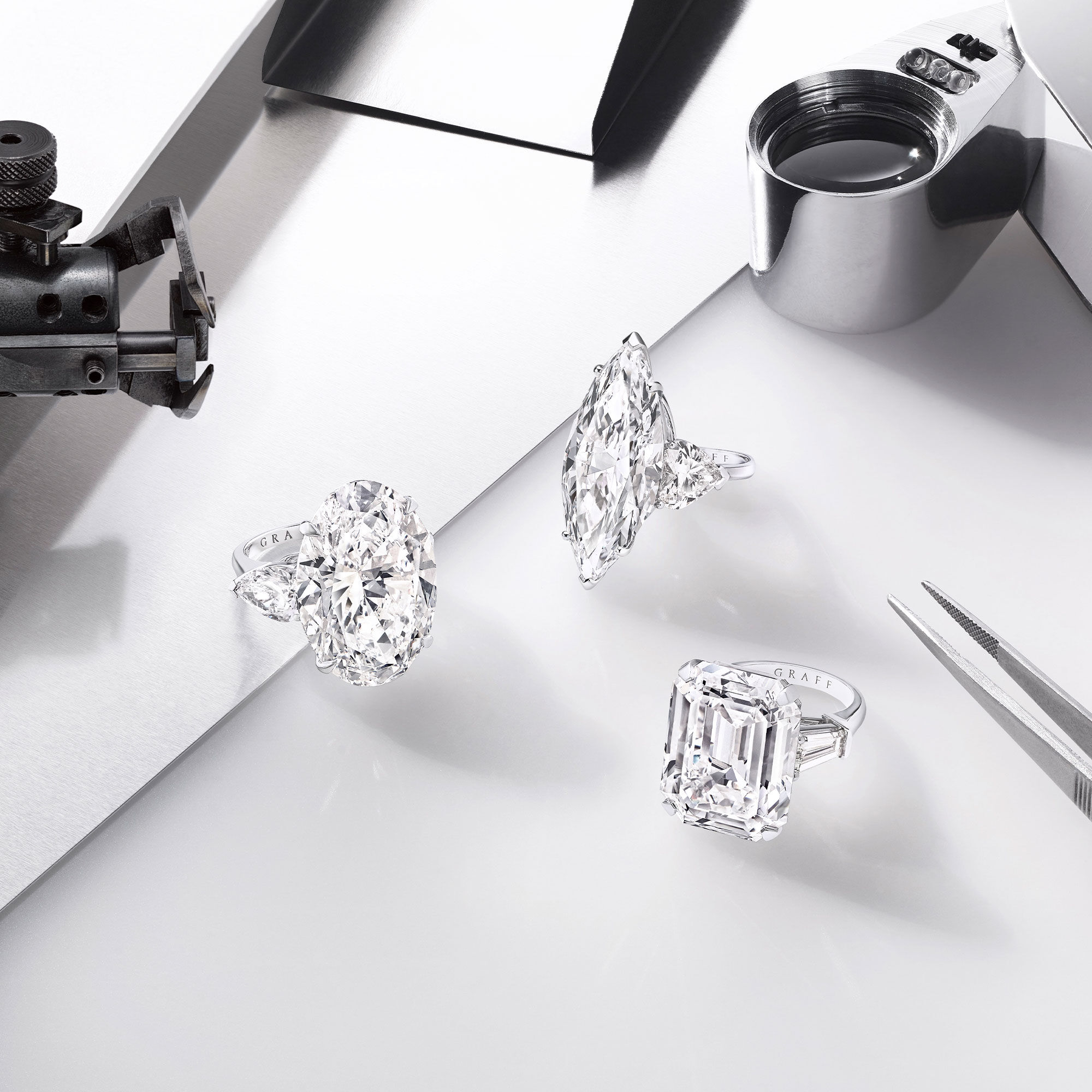 Three high jewellery diamond ring by Graff with diamond setting tools