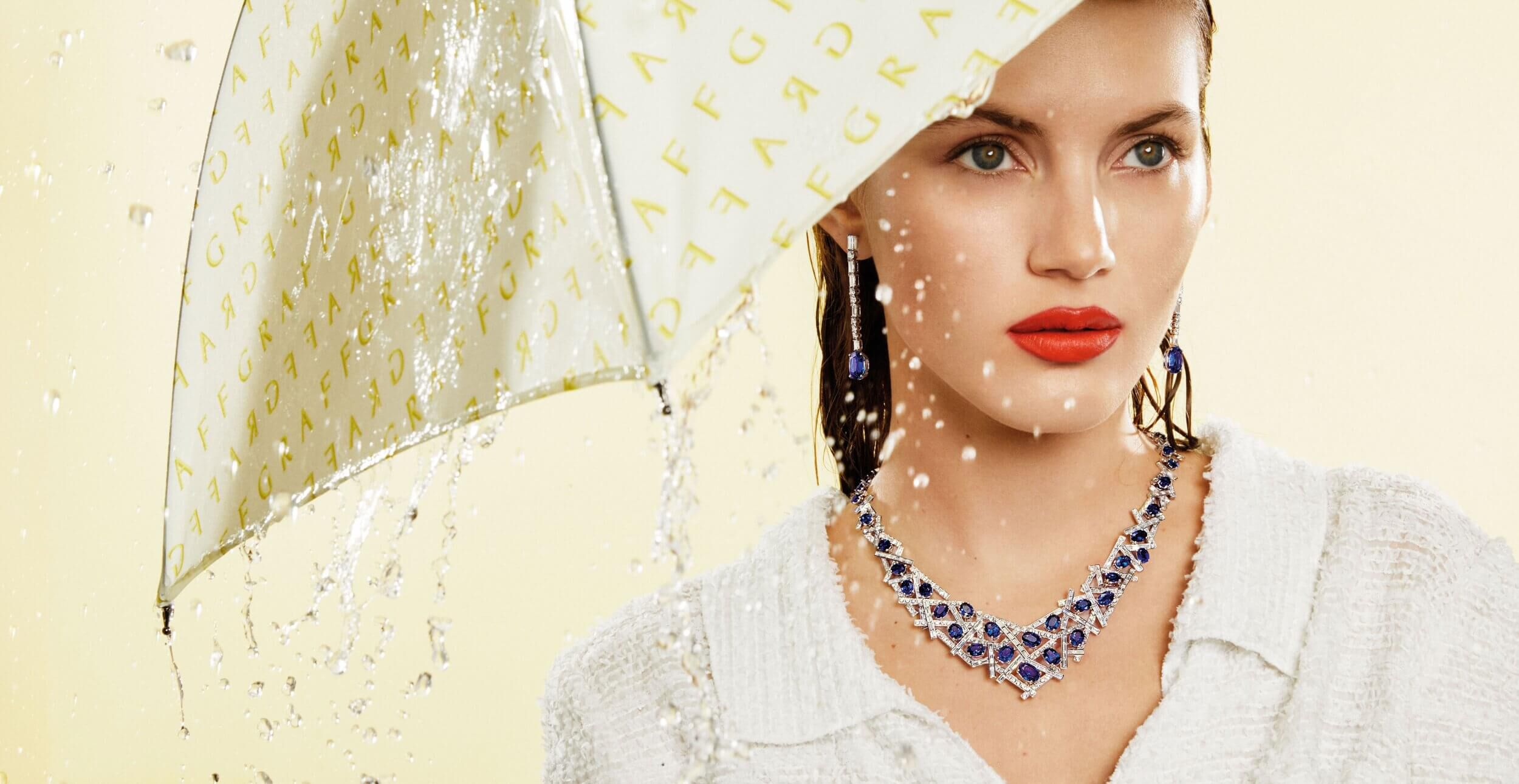 A model wearing Graff Sapphire and Diamond Earrings and Threads Collection Sapphire and Diamond Necklace