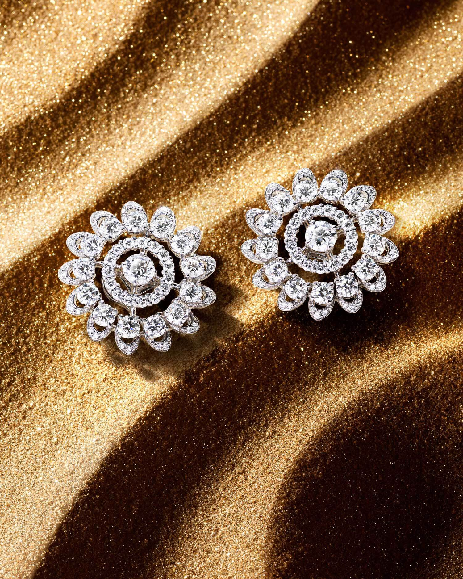 The abstract Graff Gateway motif is showcased in a pair of diamond earrings