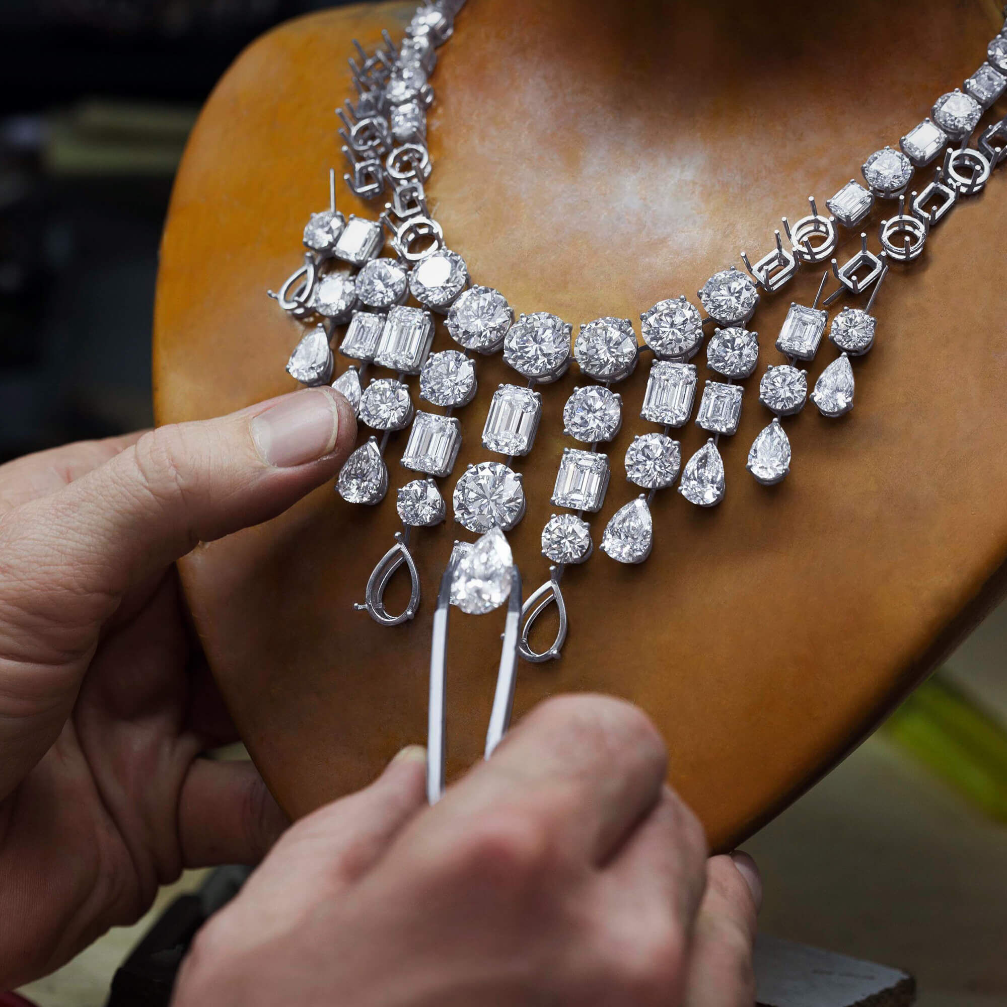 Graff Diamond setter crafting a high jewellery necklace.