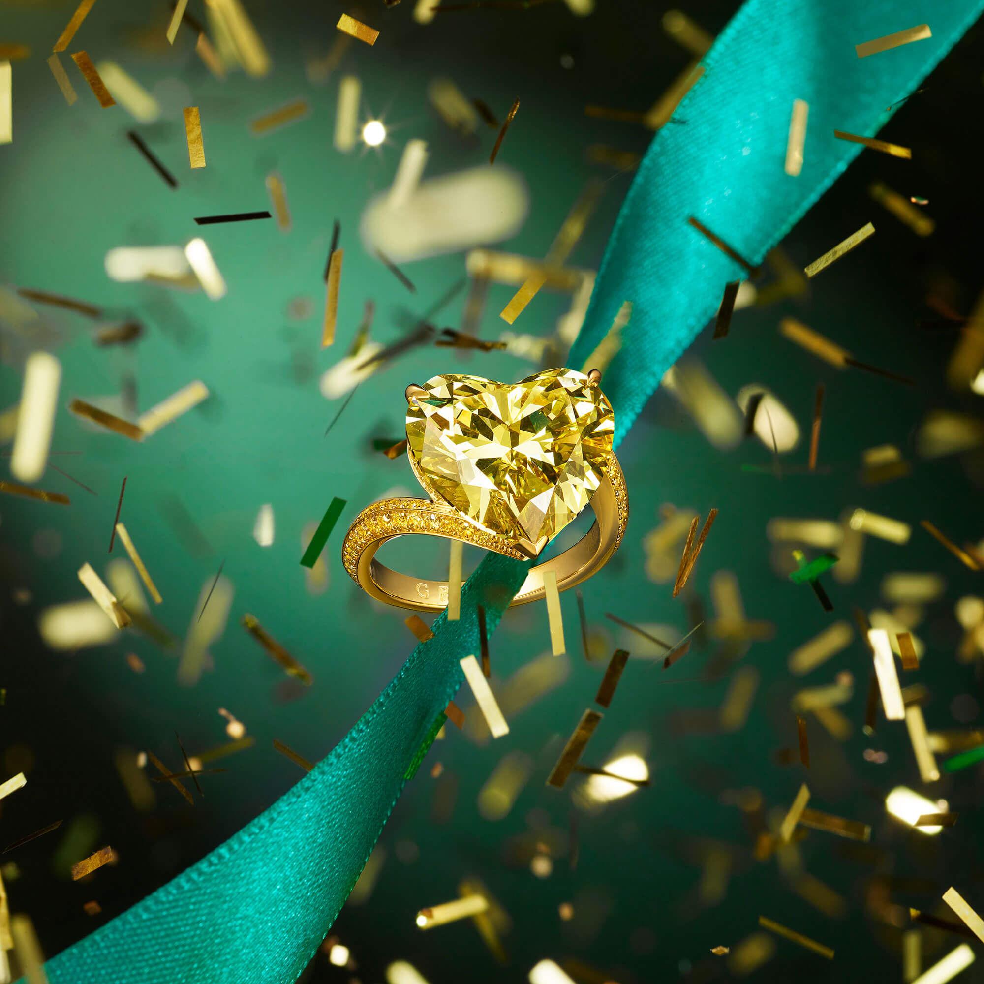 a Graff heart shaped yellow- diamond high jewellery ring with holiday season Christmas confetti
