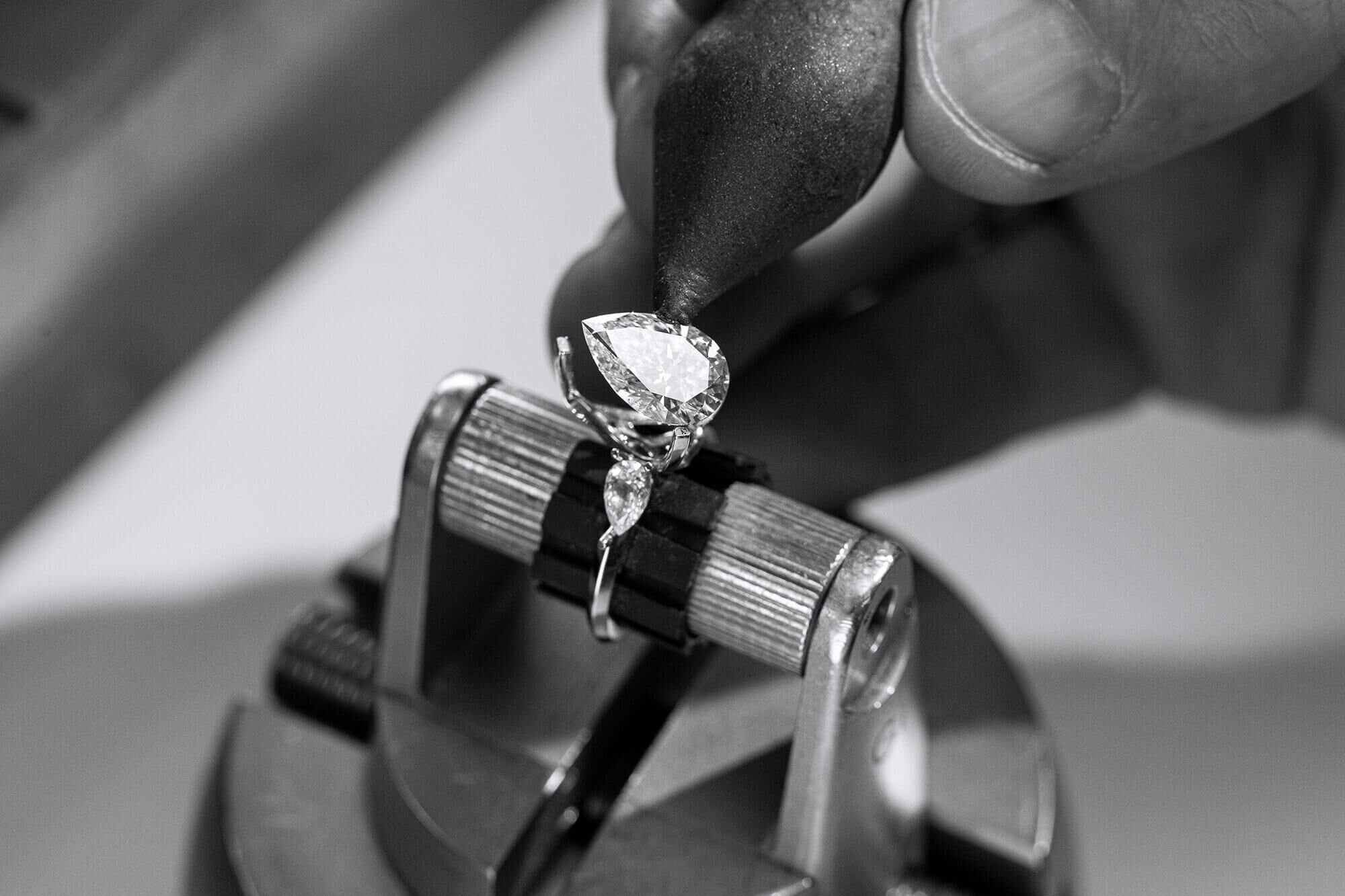 Close up of a Graff craftsman setting a diamond engagement ring