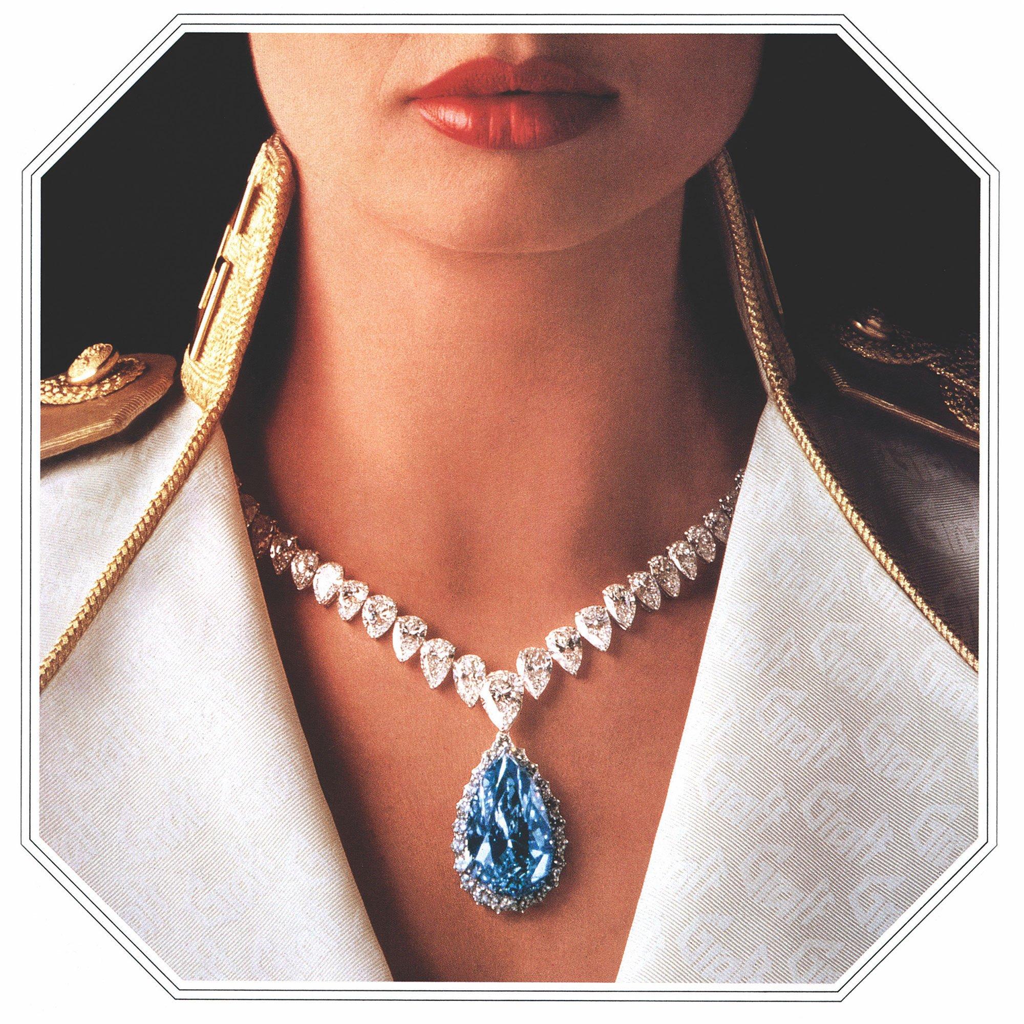 Model wearing a Graff high jewellery diamond necklace featuring pear shape blue diamond.