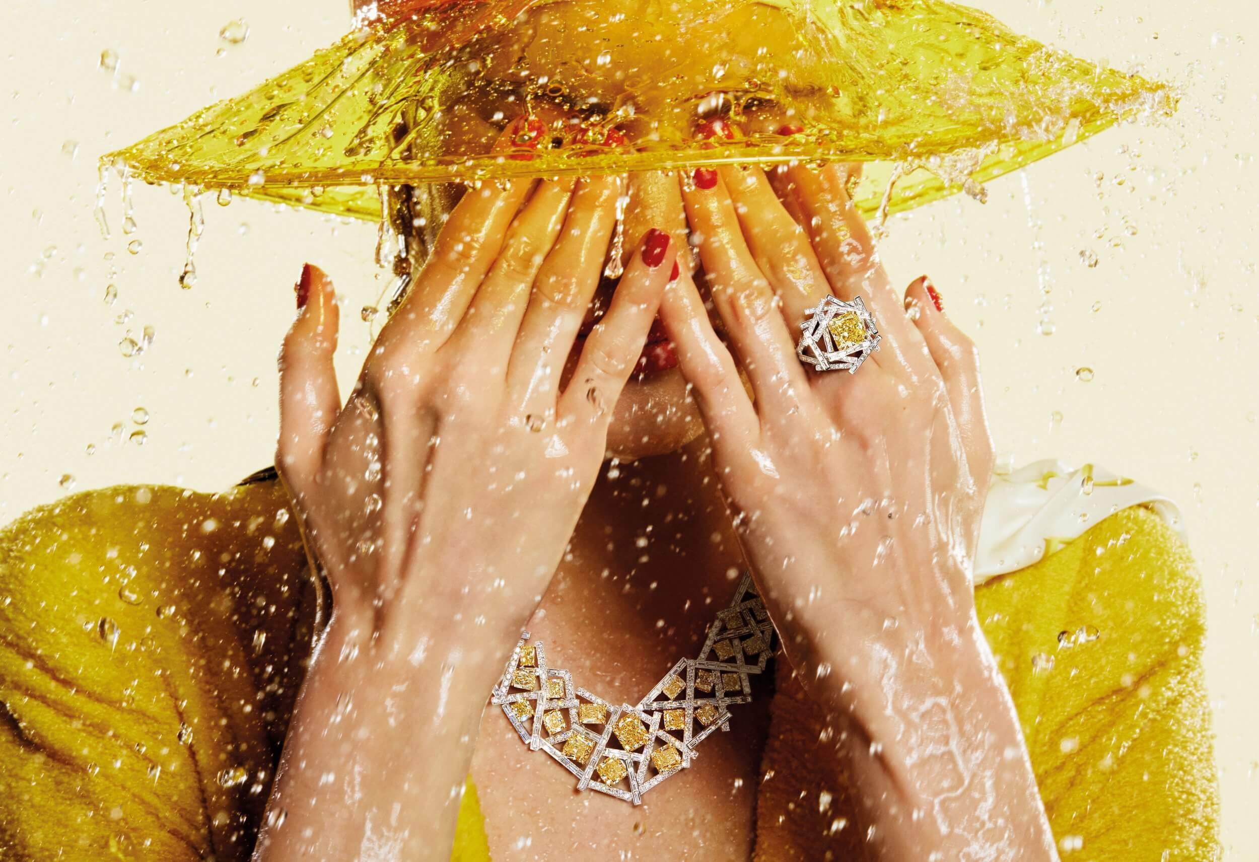 A model wearing Graff Threads Collection Yellow and White Diamond Ring and Necklace under rain