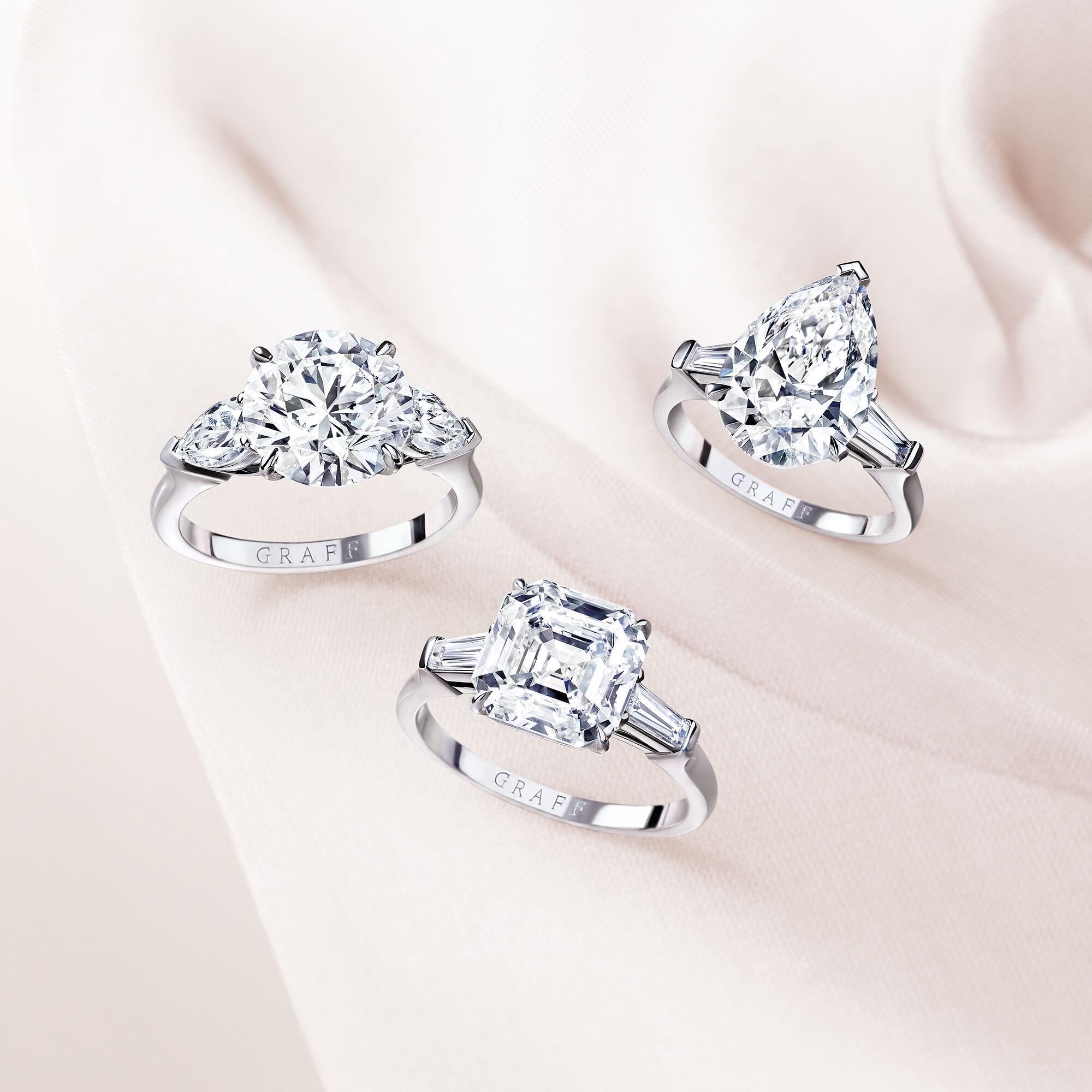 Three Graff promise engagement rings set with round diamond, pear Shape Diamond and Square Emerald Cut Diamond