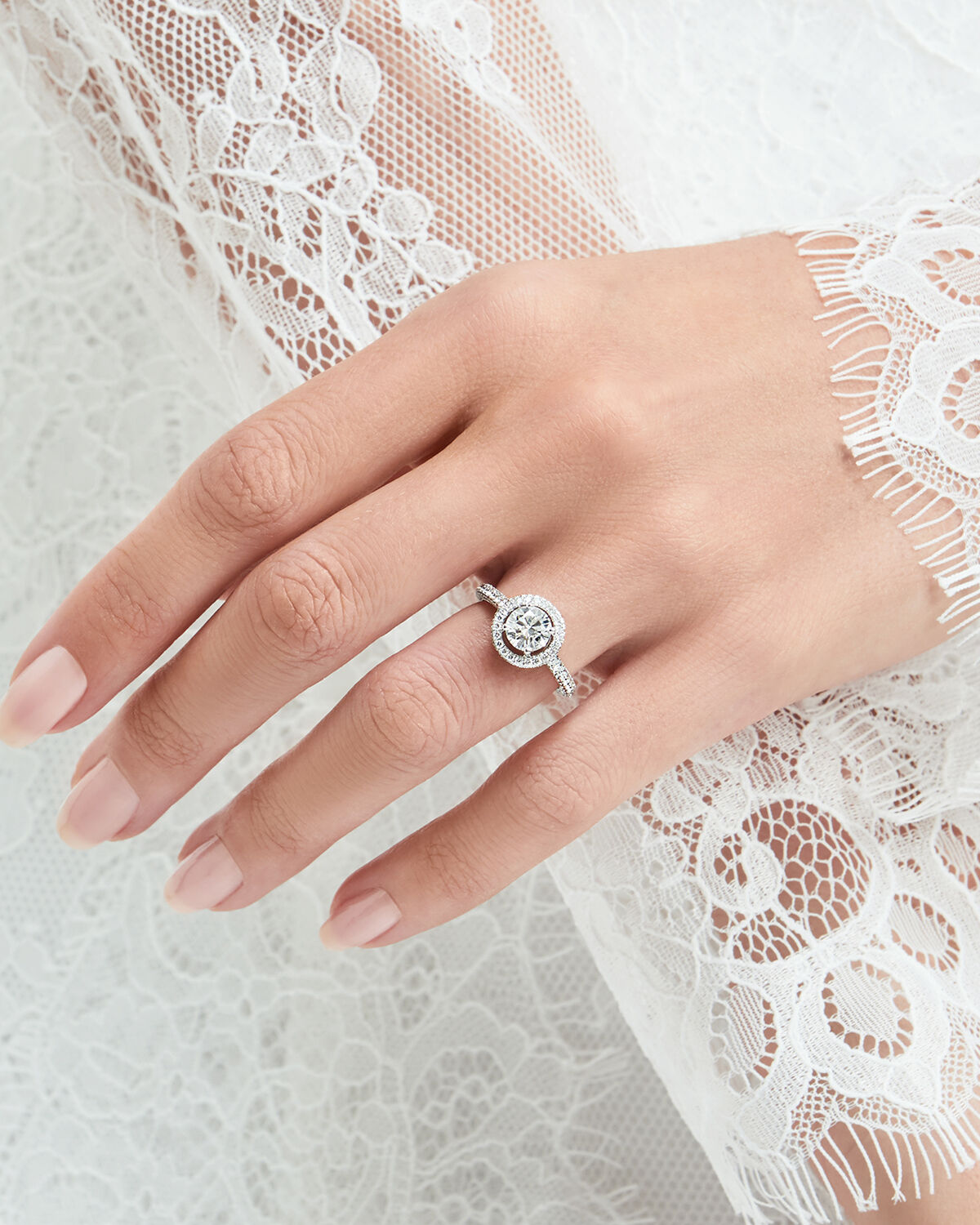 Close up of a model wearing a Graff Constellation engagement ring