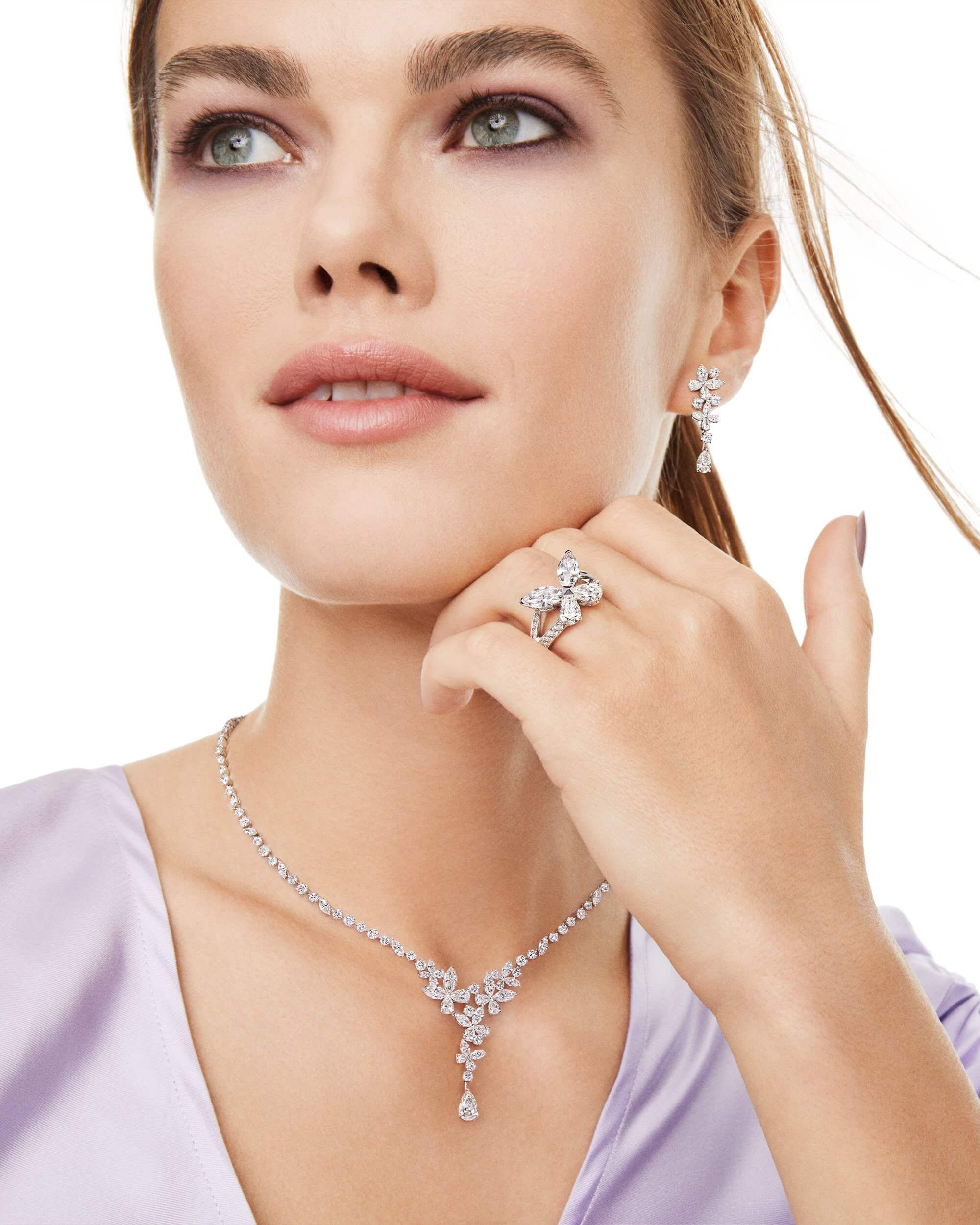 A model wearing the Graff Classic Butterfly Collection earrings, ring and necklace