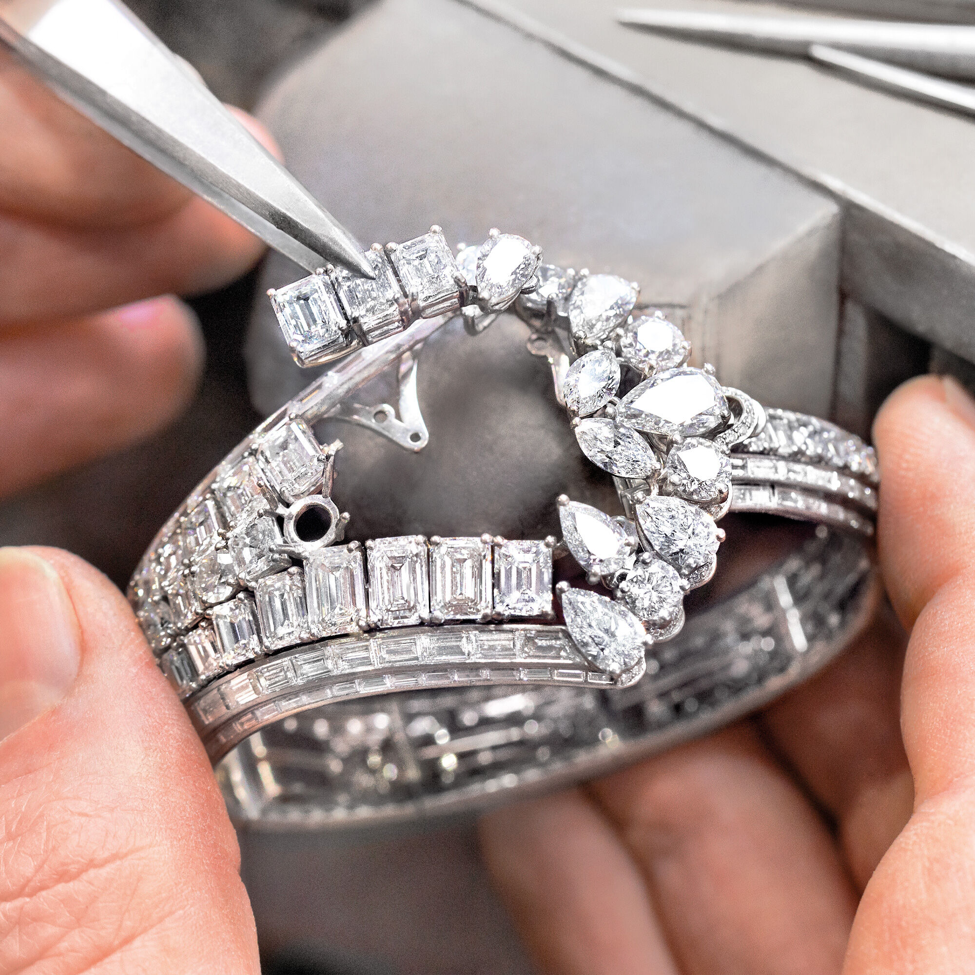 Garff Diamond setter seting the Graff Oval Diamond Secret Watch from the Graff unique timepieces collection