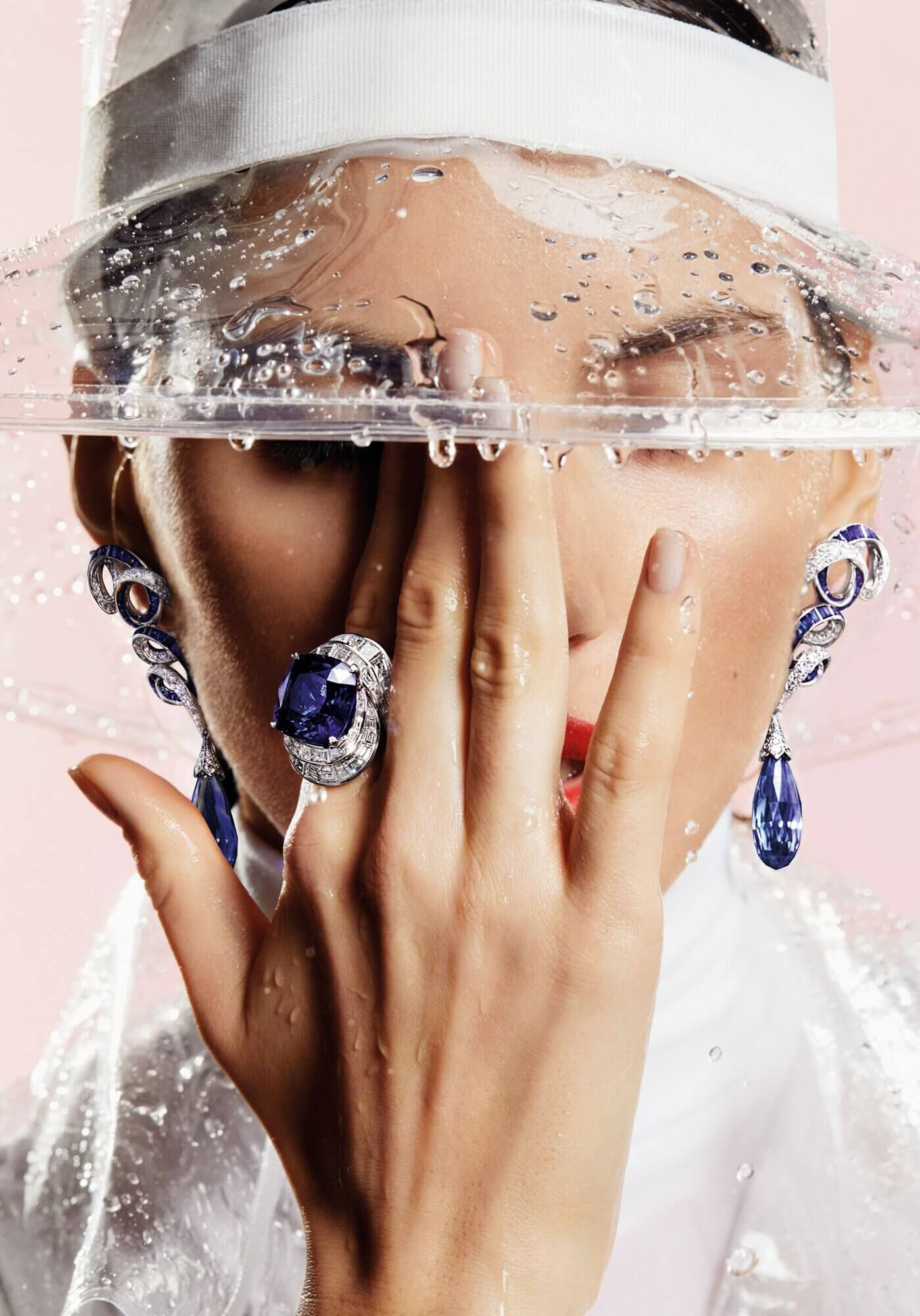 Close up of a model wearing a Graff Sapphire and Diamond Ring and a pair of Inspired by Twombly Collection Diamond Earrings