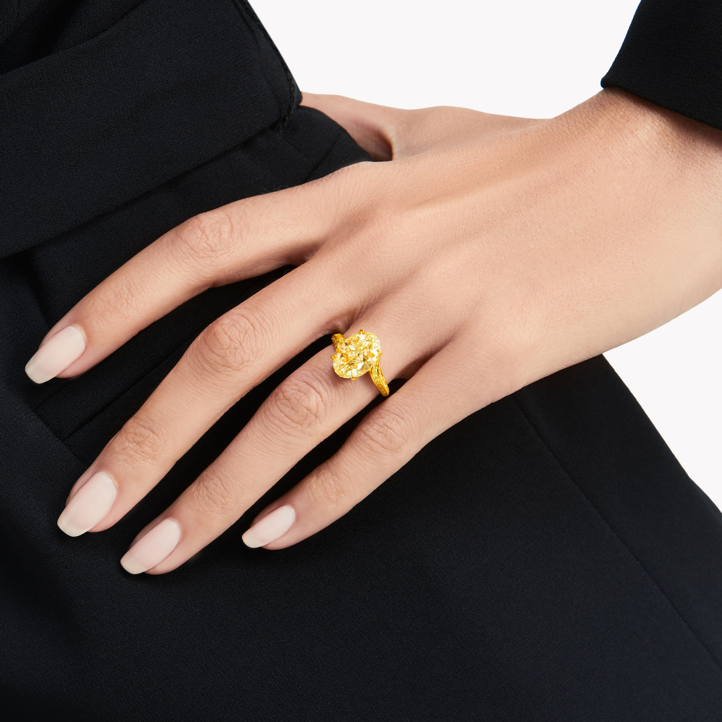 Model wearing a Graff oval yellow diamond ring.